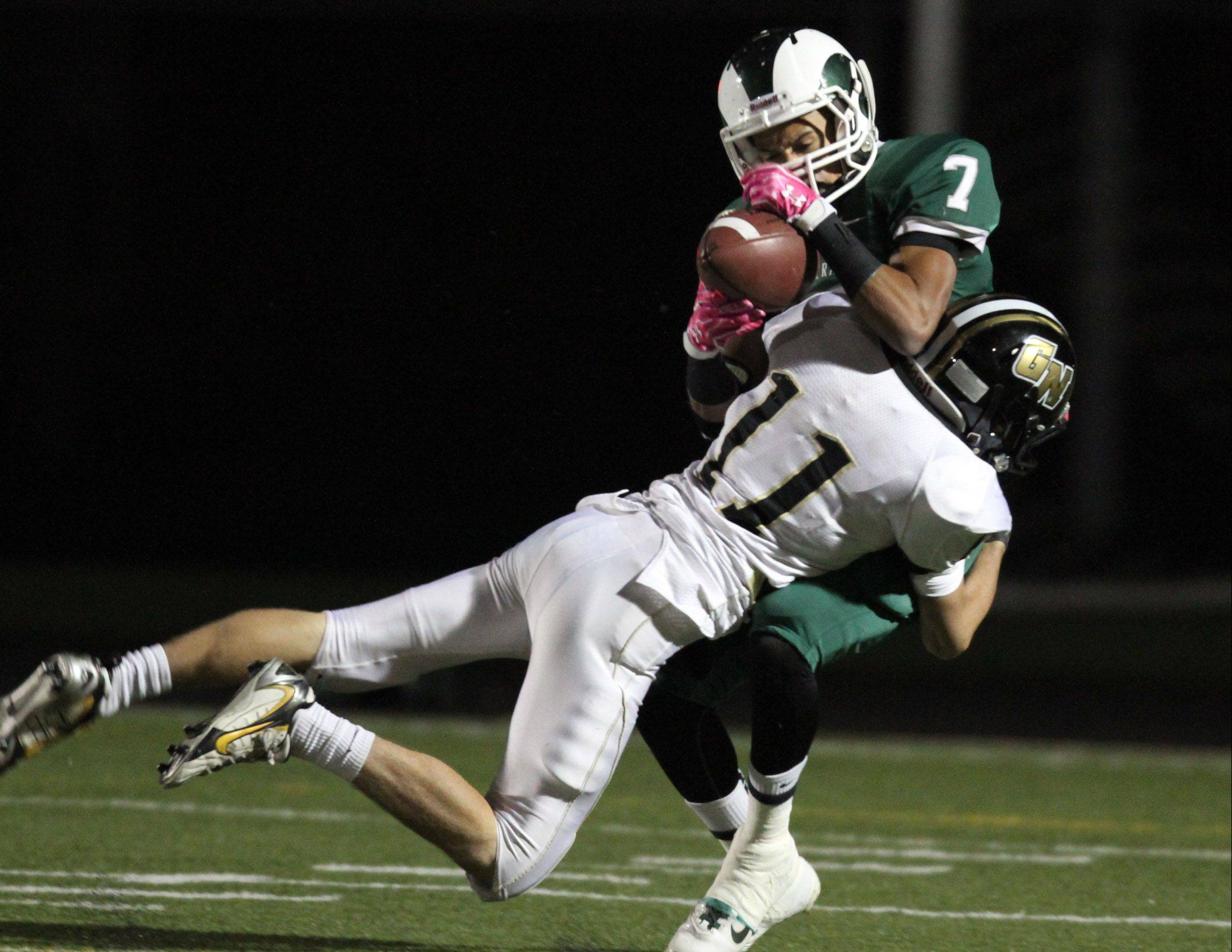 Grayslake Central's Devon Osburn is tackled by Grayslake North defender Jake Geary just last season. Geary is now an assistant coach with the Knights.