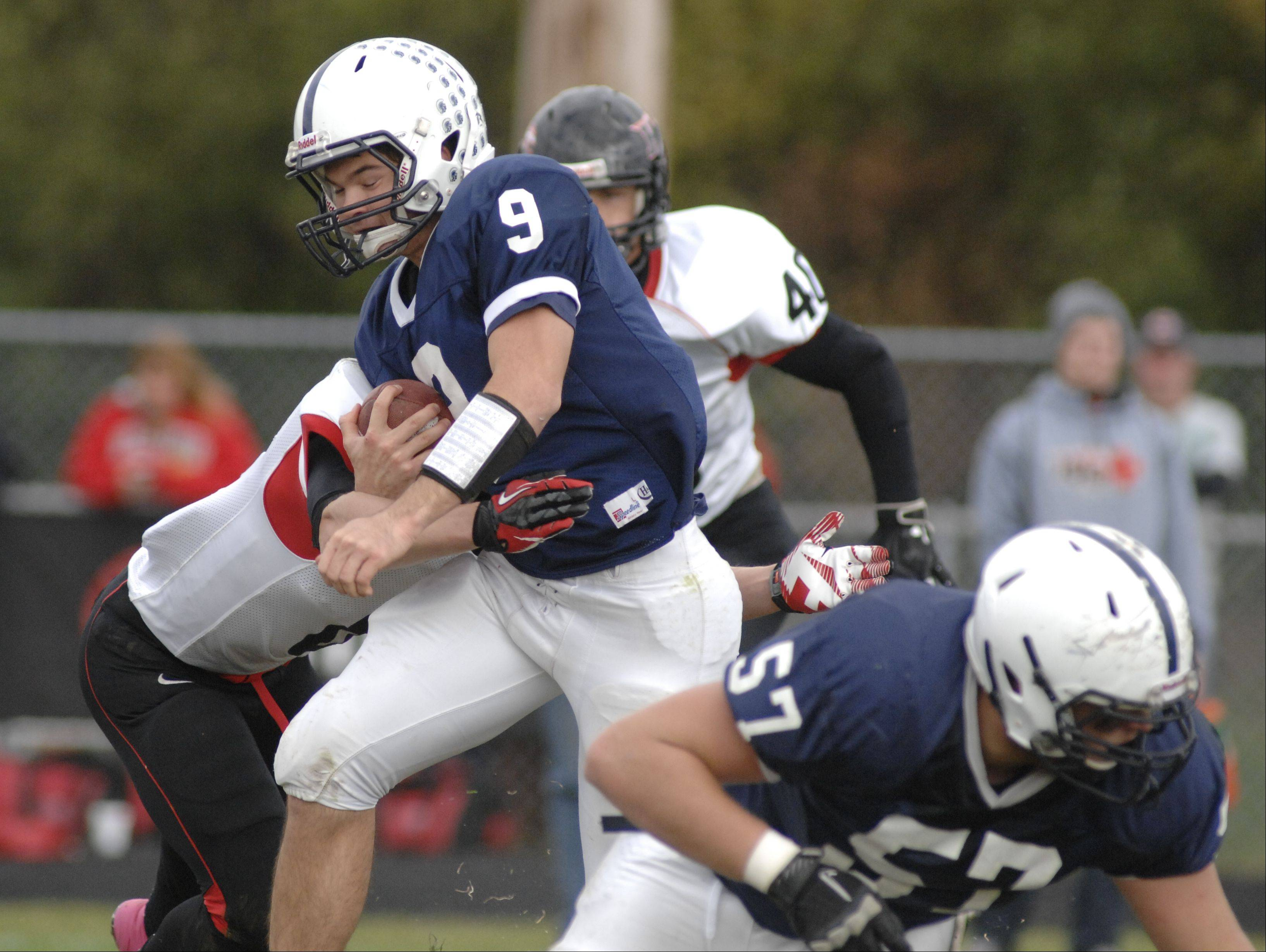 Senior quarterback Quinn Baker (9) has been one of the leaders of the 7-0 Cary-Grove football team this season.