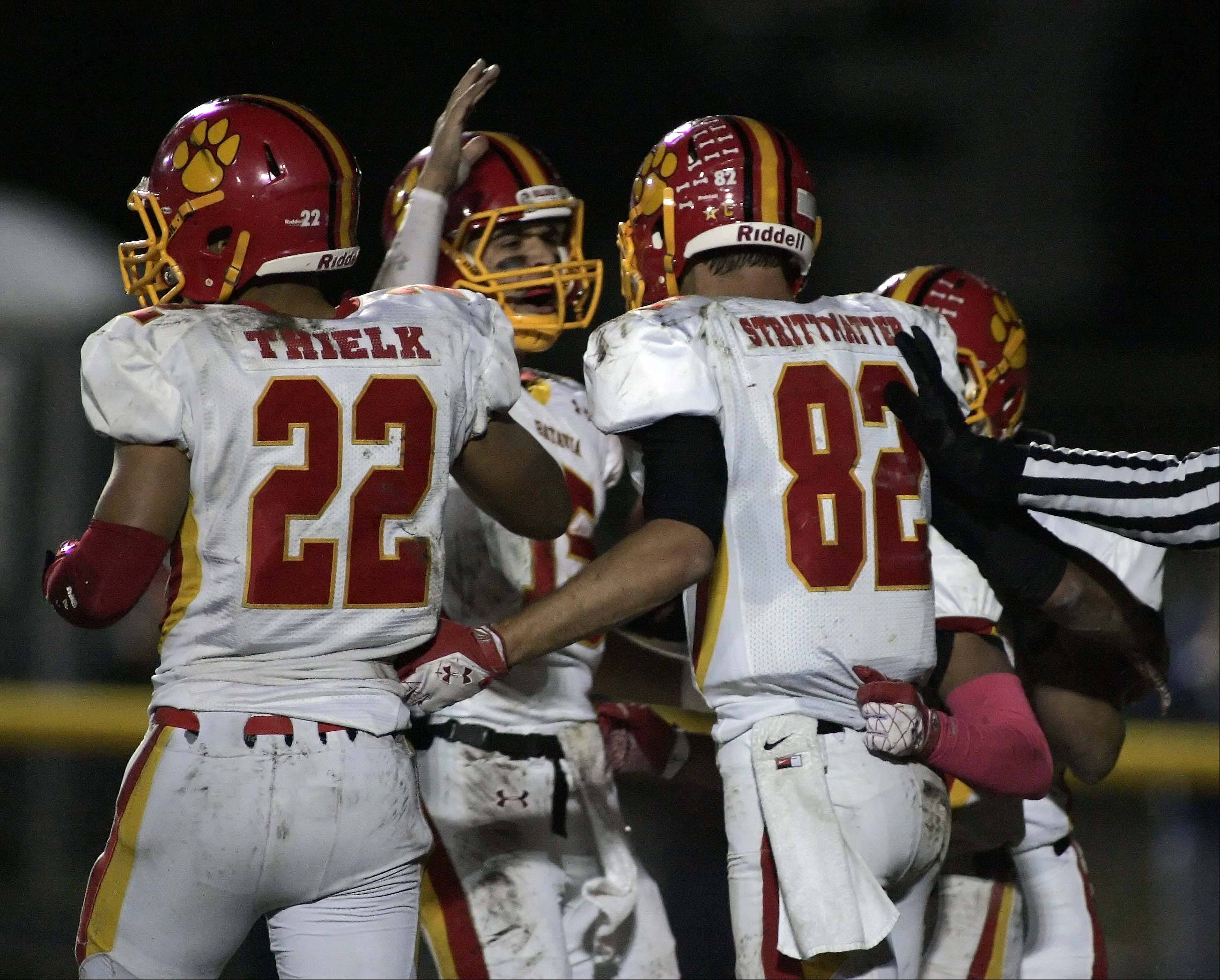 Batavia's Zachary Strittmatter (82) is greeted by his teammates after a touchdown in the second quarter at St. Charles East Friday.