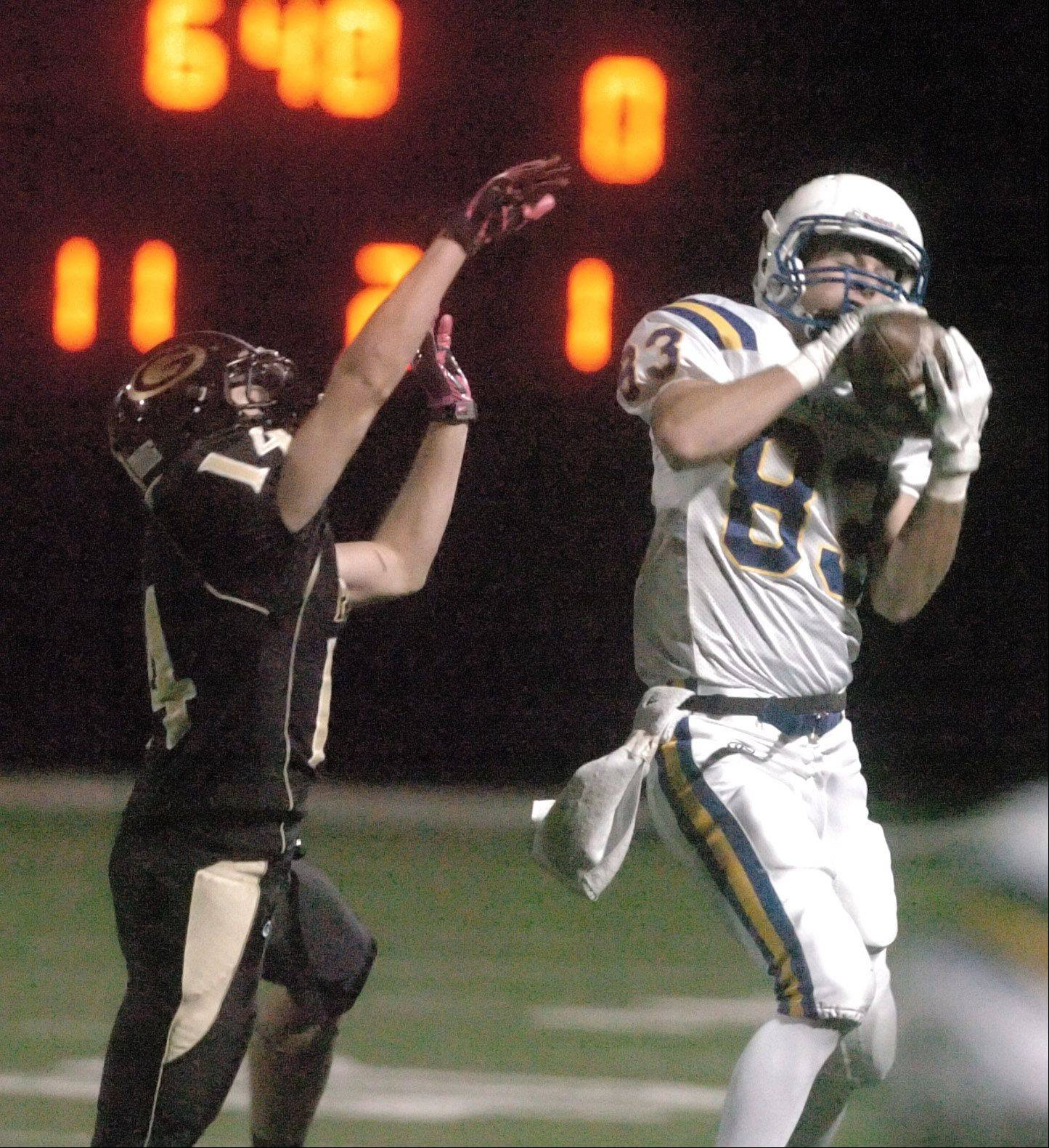 Ryan Storto of Glenbard North jumps to stop Matt Biegalski of Wheaton North.