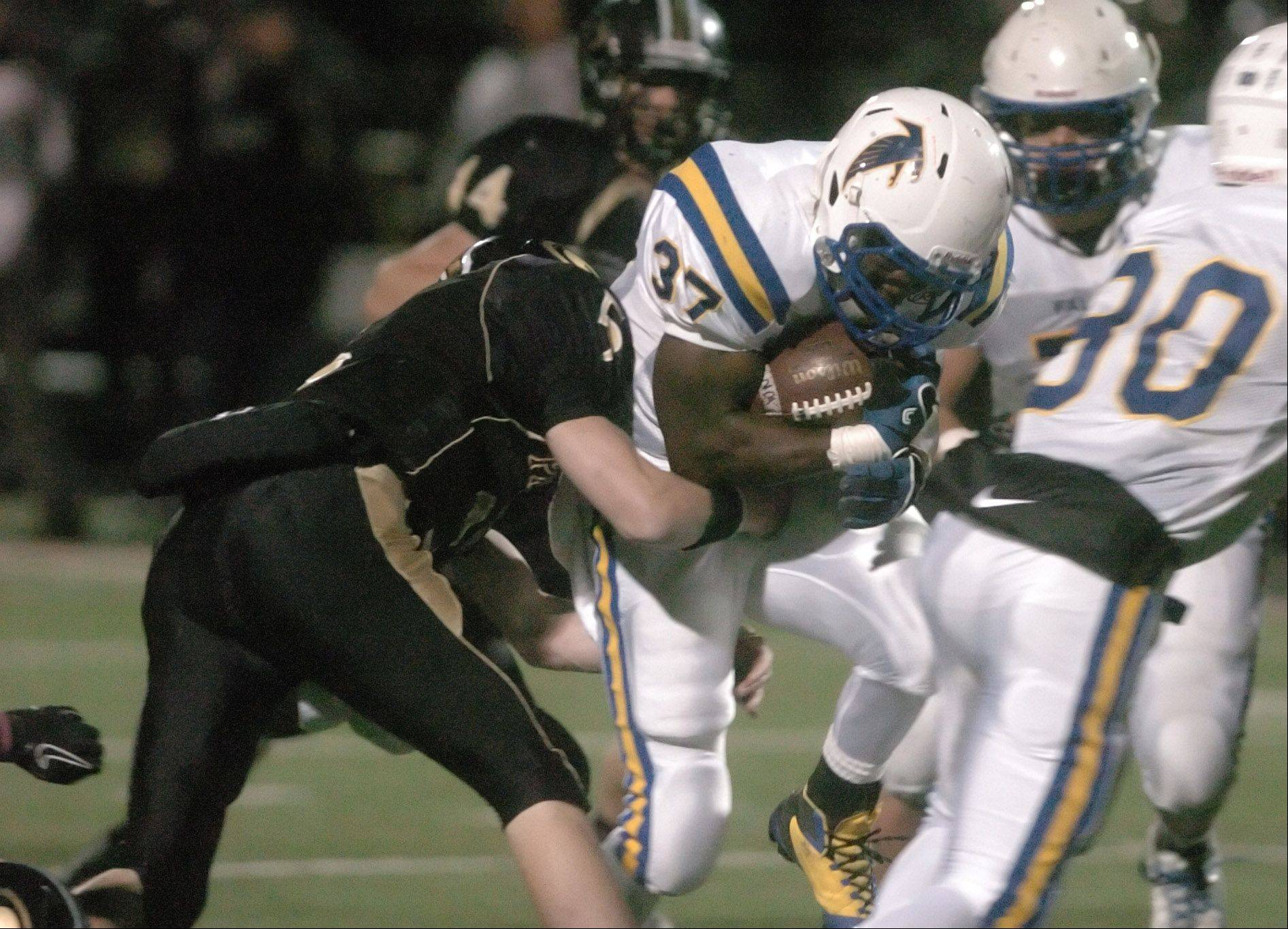 Patrick Sharo of Wheaton North pushes through a hole .