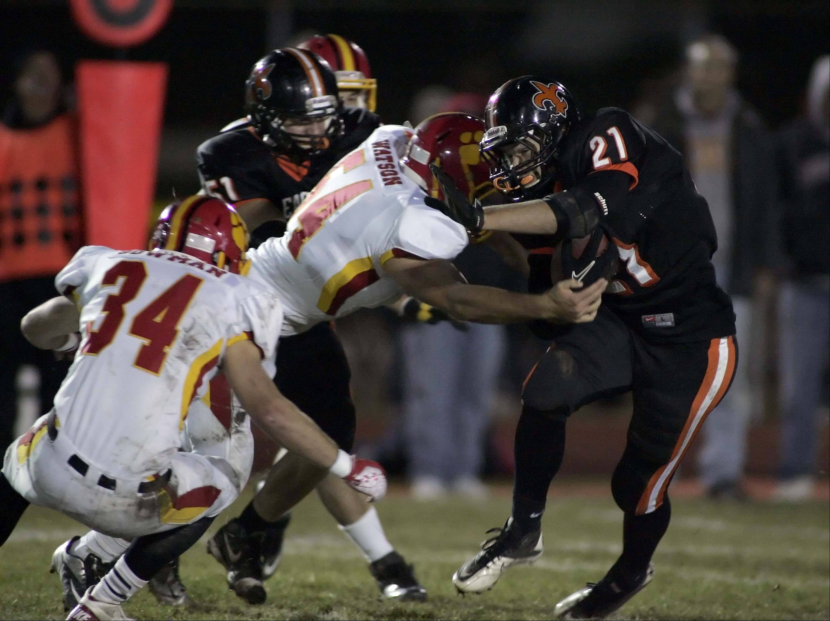 St. Charles East's Erik Anderson pushes past Batavia's Michael Watson .