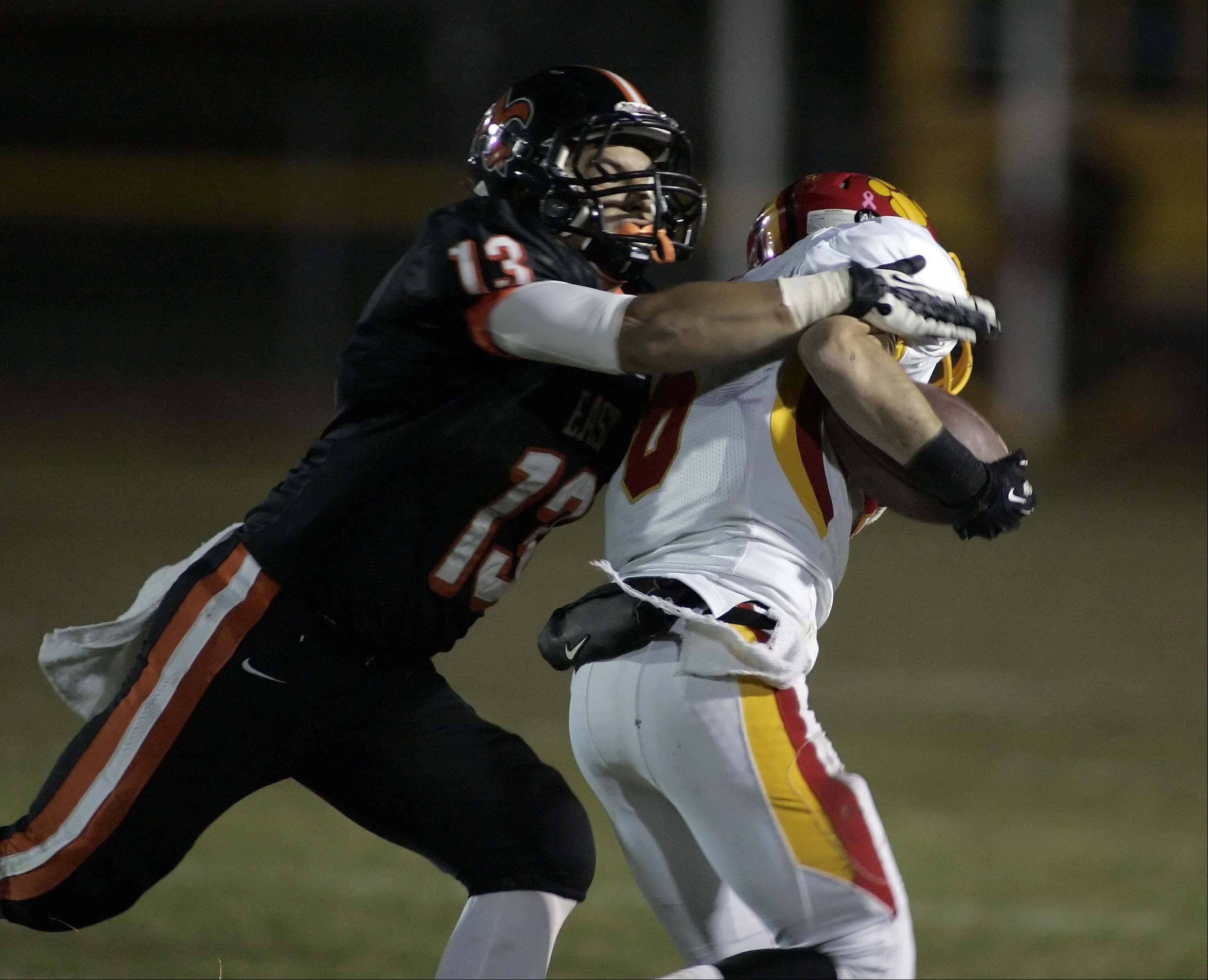 St. Charles East's Anthony Sciarrino wraps up Batavia's Rourke Mullins.