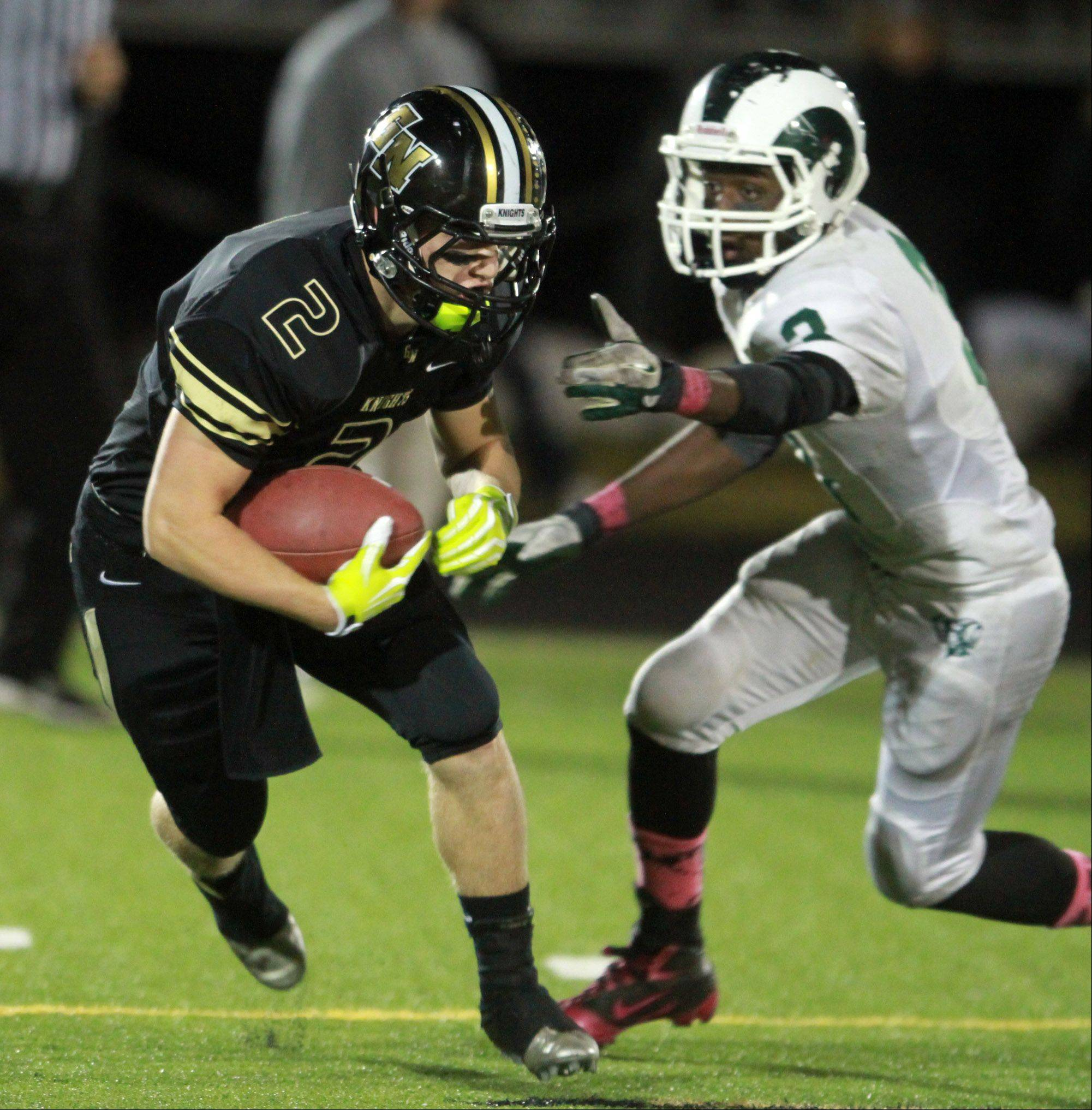 Grayslake North wide receiver Vincent Smith runs past Grayslake Central defender Davonta Jennings at Grayslake North.