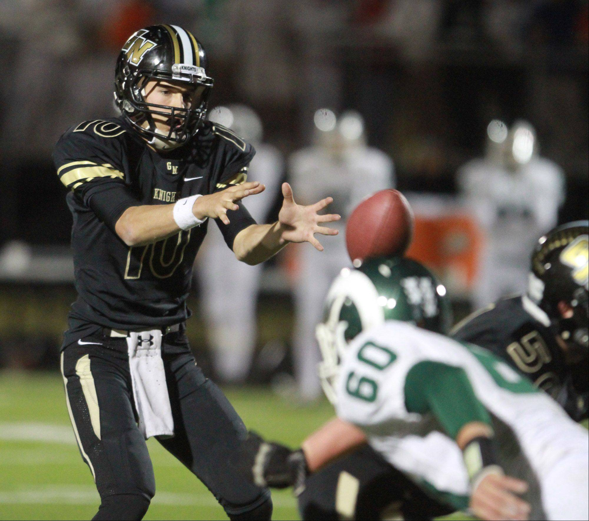 Grayslake North quarterback Anthony Fish takes a snap.