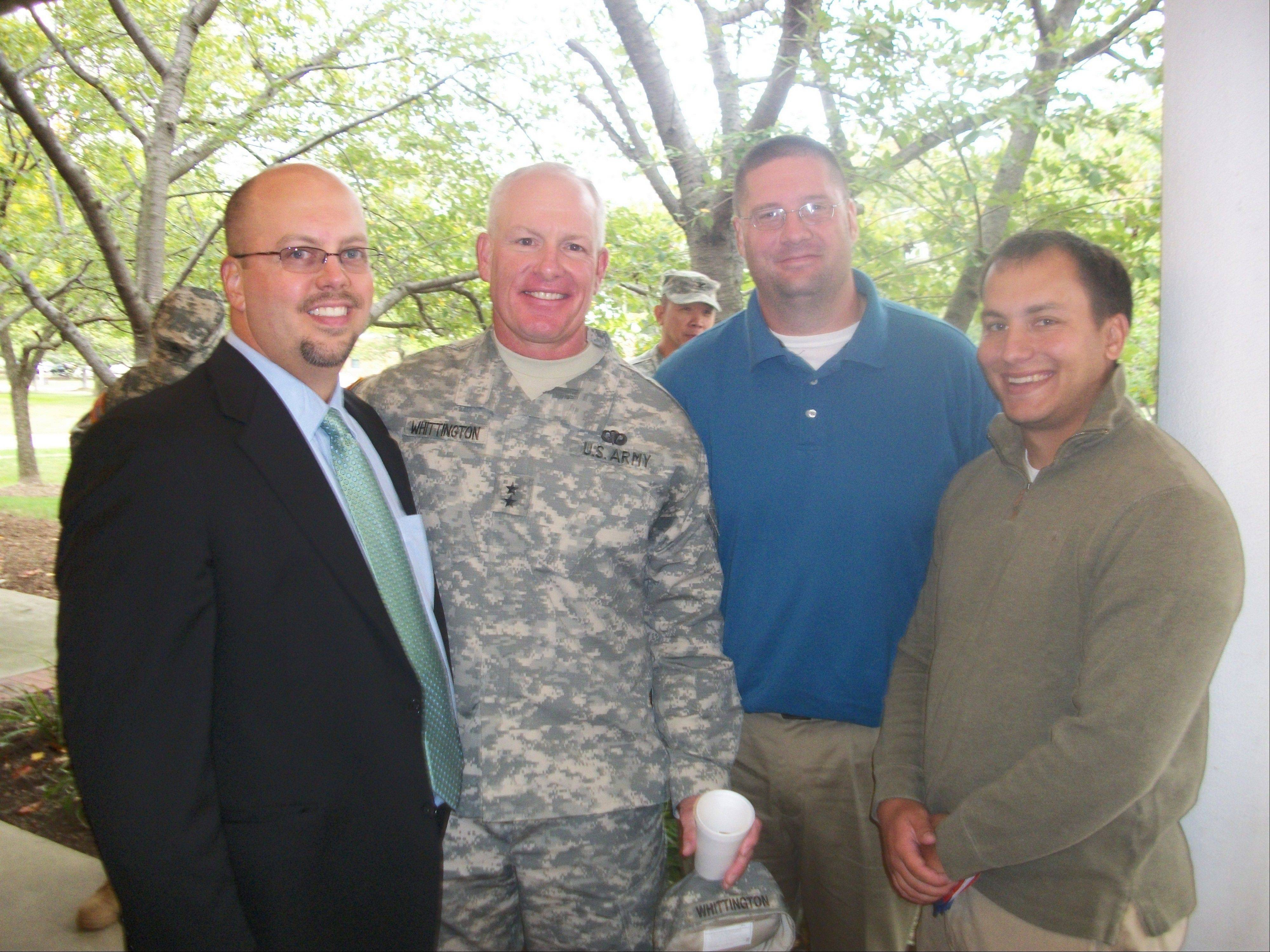 On the weekend of Oct. at Fort Belvoir, Va., General Charles Whittington, Jr. - known as Coach Whitt to the Grayslake Central football program. - was presented with his second star at the 29th Infantry's Change of Command Ceremony. For the past five seasons, Whittington has served as an assistant football coach at Grayslake Central. Head coach Ben Ault, assistant Danny Catanzaro, right, and former Rams head coach Nick Goshe, left, were included in the ceremony.