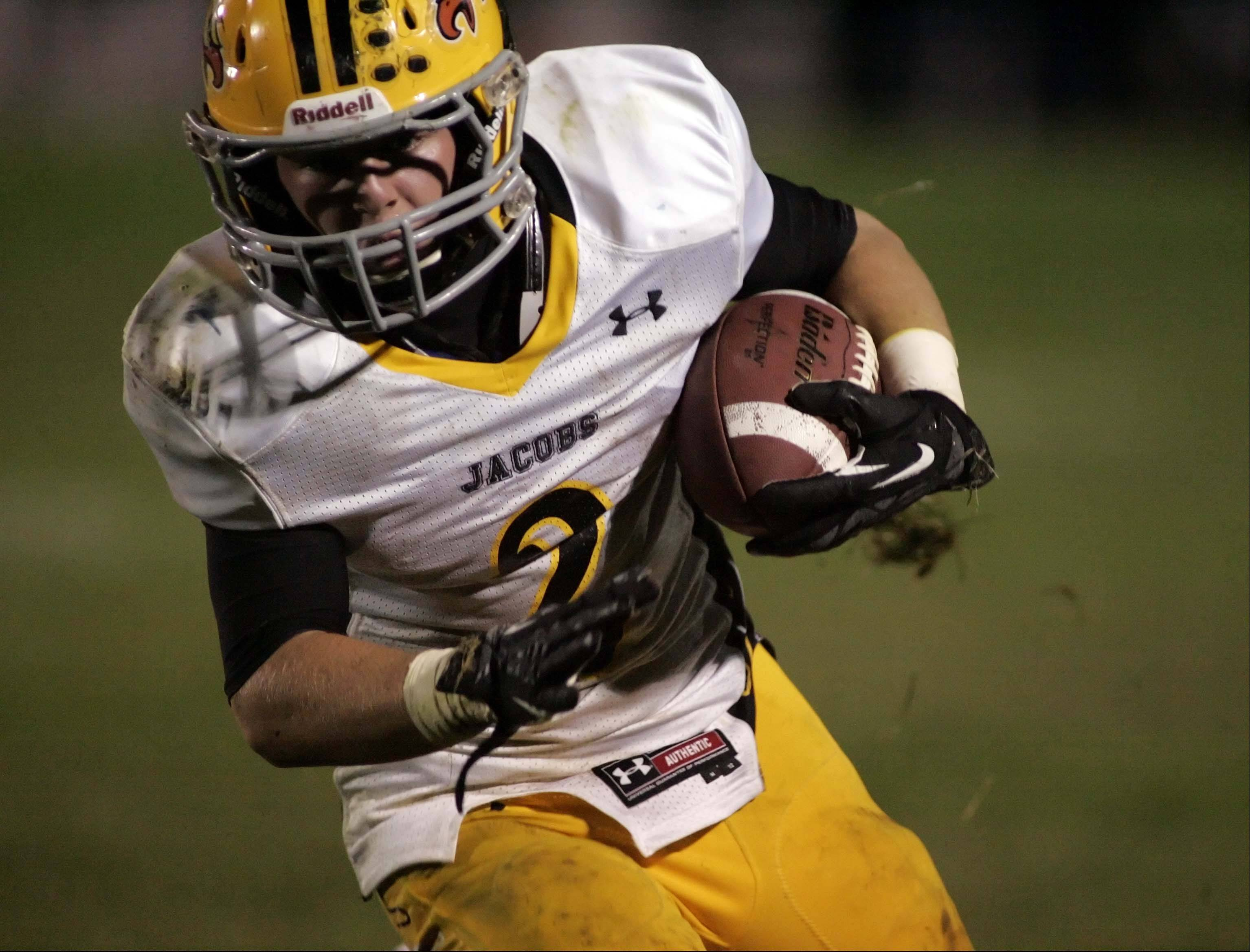 Jacobs' Greg Sidor (2) runs for yardage earlier this season. The Golden Eagles have a playoff berth on the line Friday night when they visit Dundee-Crown.