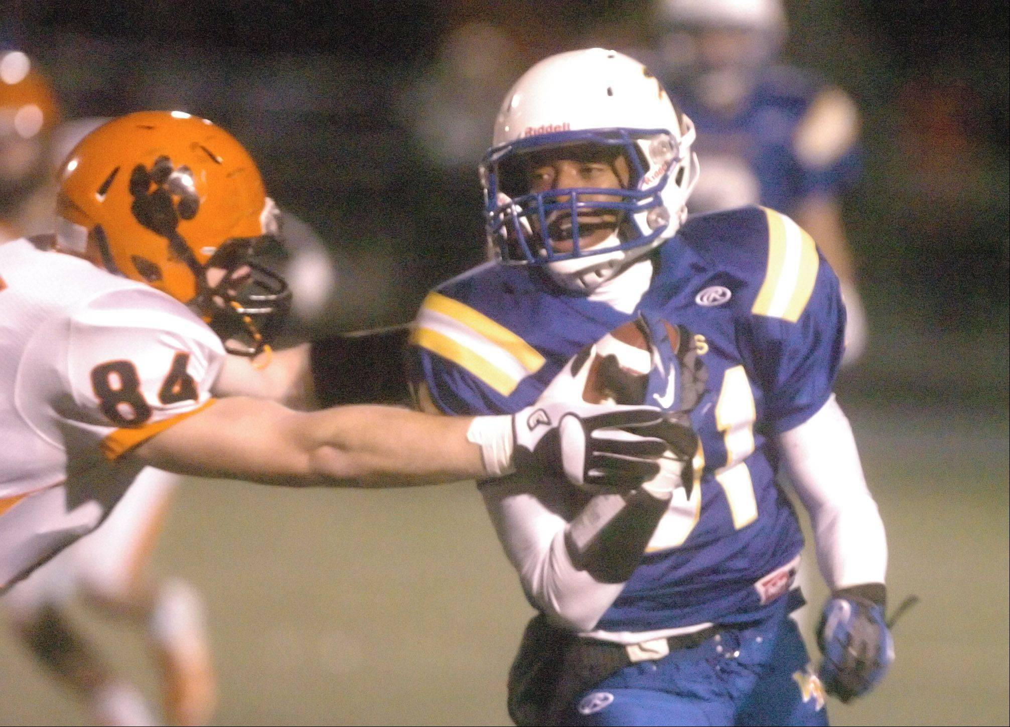Brian Welch of Wheaton Warrenville South tries to stop Jaylen Howze of Wheaton North during the Wheaton Warrenville South at Wheaton North game Friday.