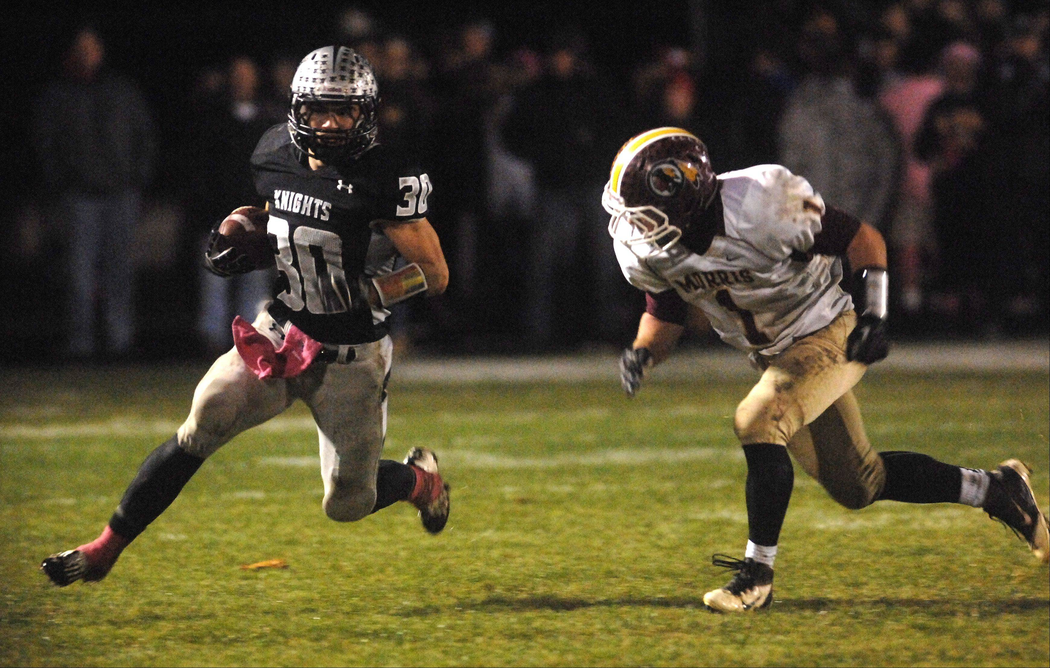 Kaneland's Jesse Balluff picks up a big gain as he gets around Morris' Jake Hogan during Friday's game in Maple Park.