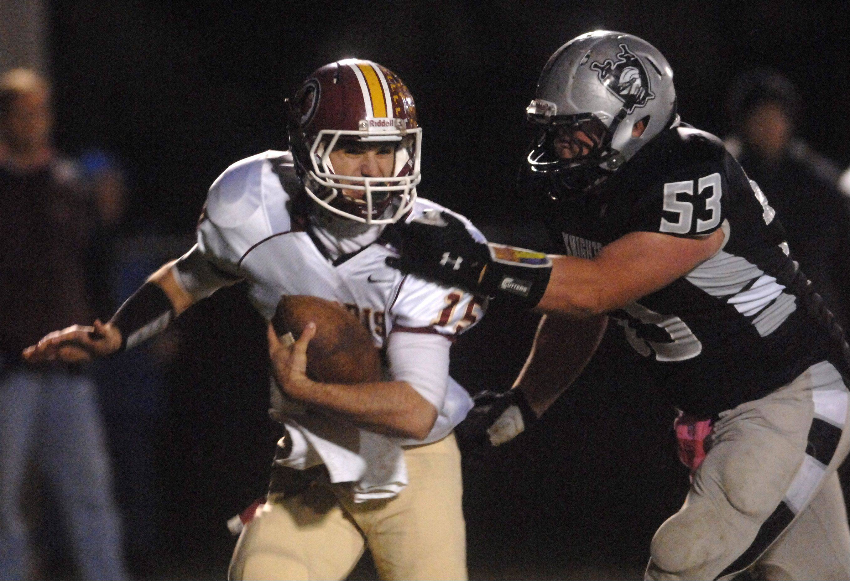Kaneland's Justin Diddell sacks Morris quarterback Zach Cinnamon during Friday's game in Maple Park.
