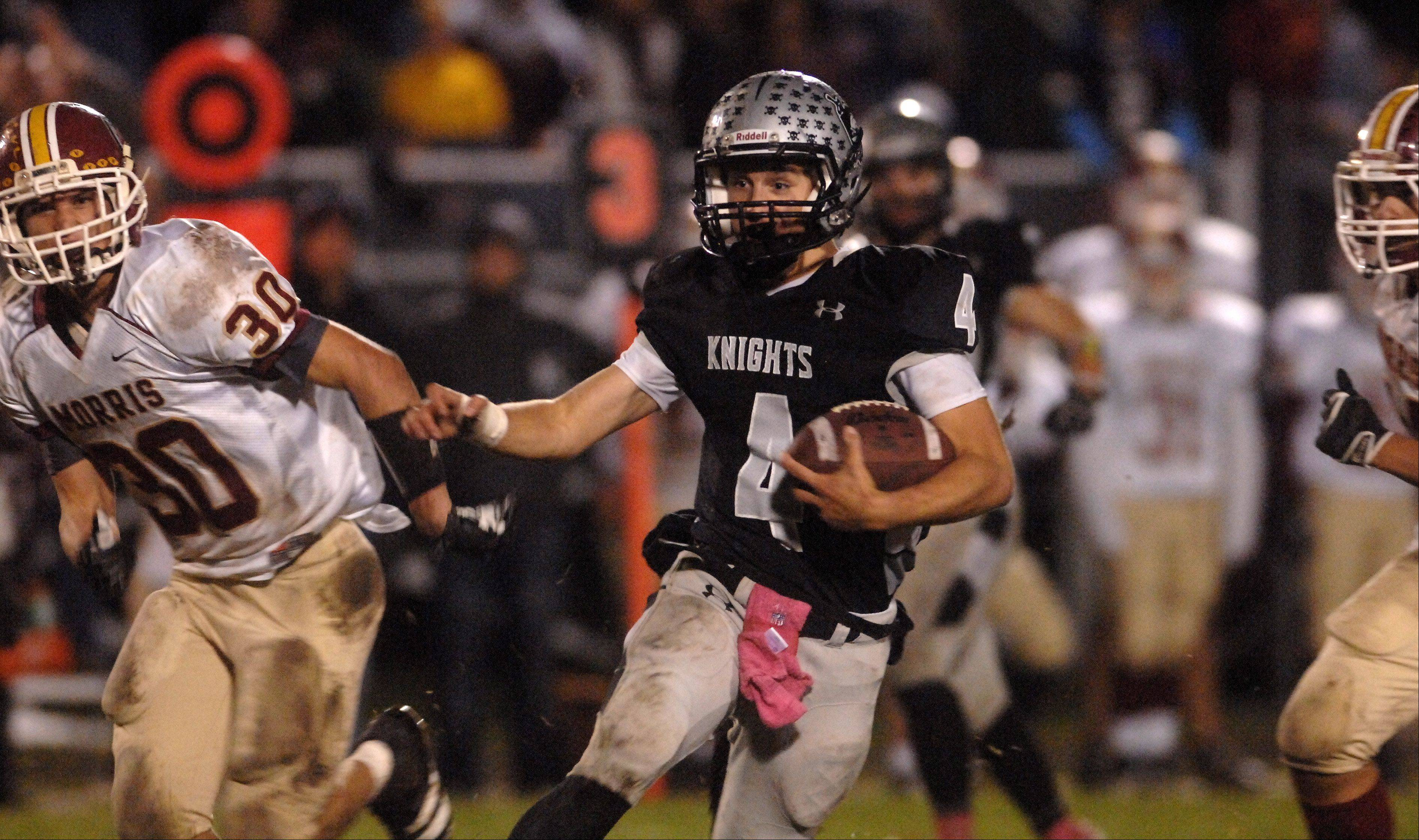 Kaneland's Drew David breaks a big run on the game-winning drive against Morris during Friday's game in Maple Park.