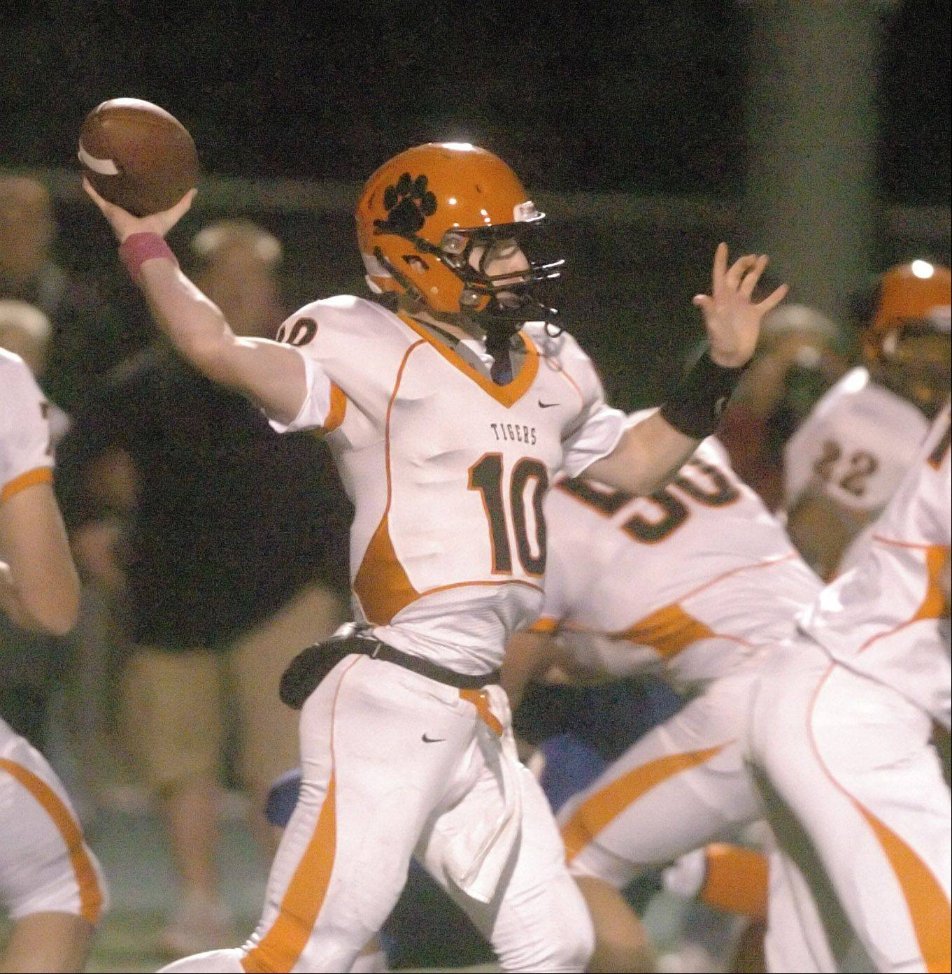 Ryan Graham of Wheaton Warrenville South fires a pass.