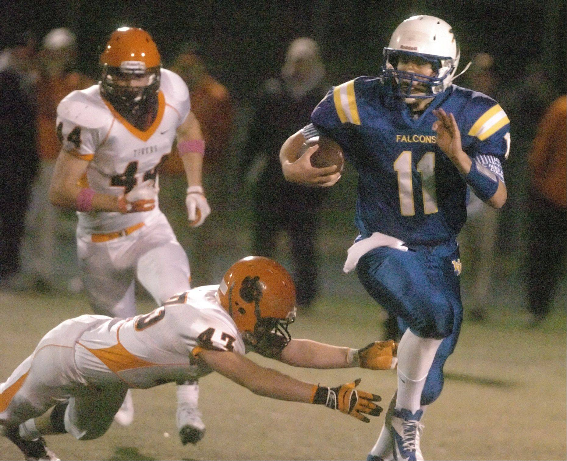 Robert Herman of Wheaton Warrenville South tries to pull down John Peltz of Wheaton North.