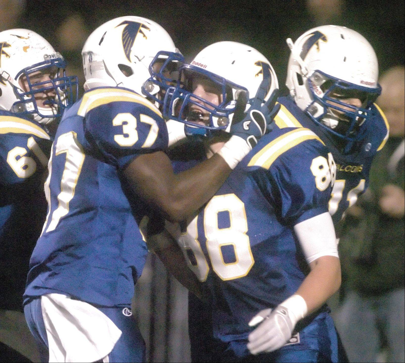 Patrick Sharp,left, and Tom Colletti of Wheaton North celebrate after a touchdown.
