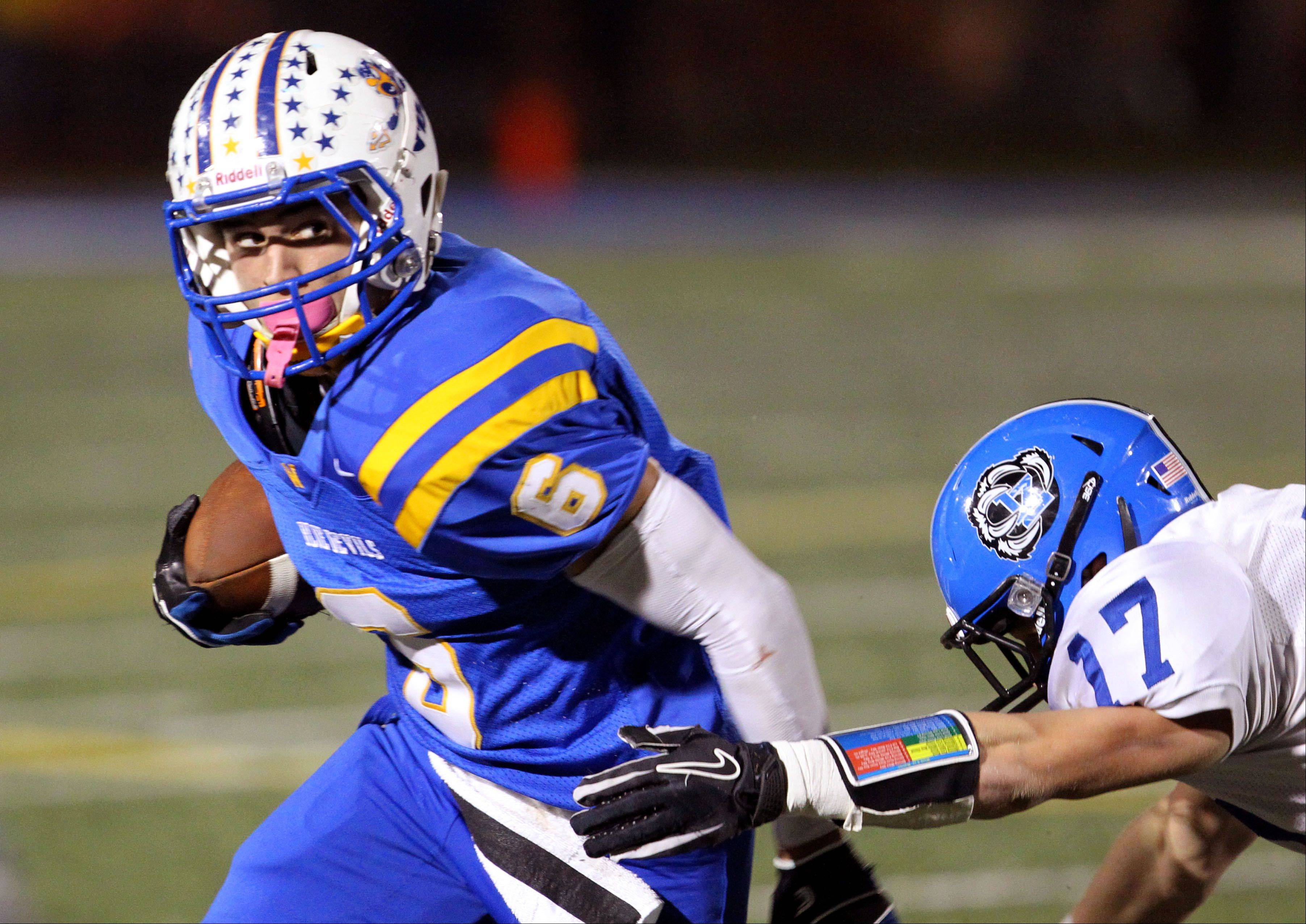 Warren's Connor Iwema gets around Lake Zurich's Anthony Baca.