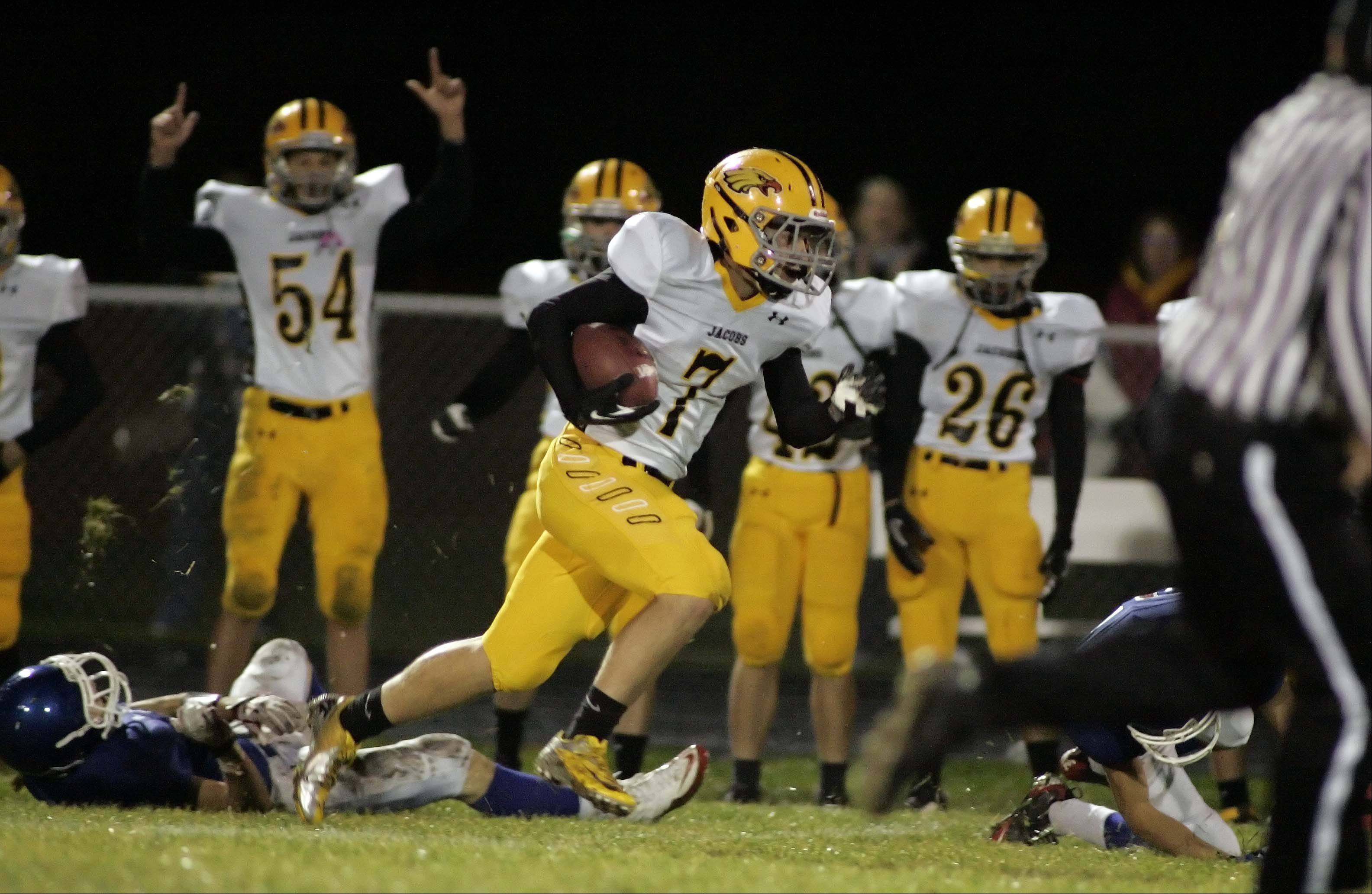 Jacobs' Hunter Williams works his way down the sideline for a touchdown during the first quarter.