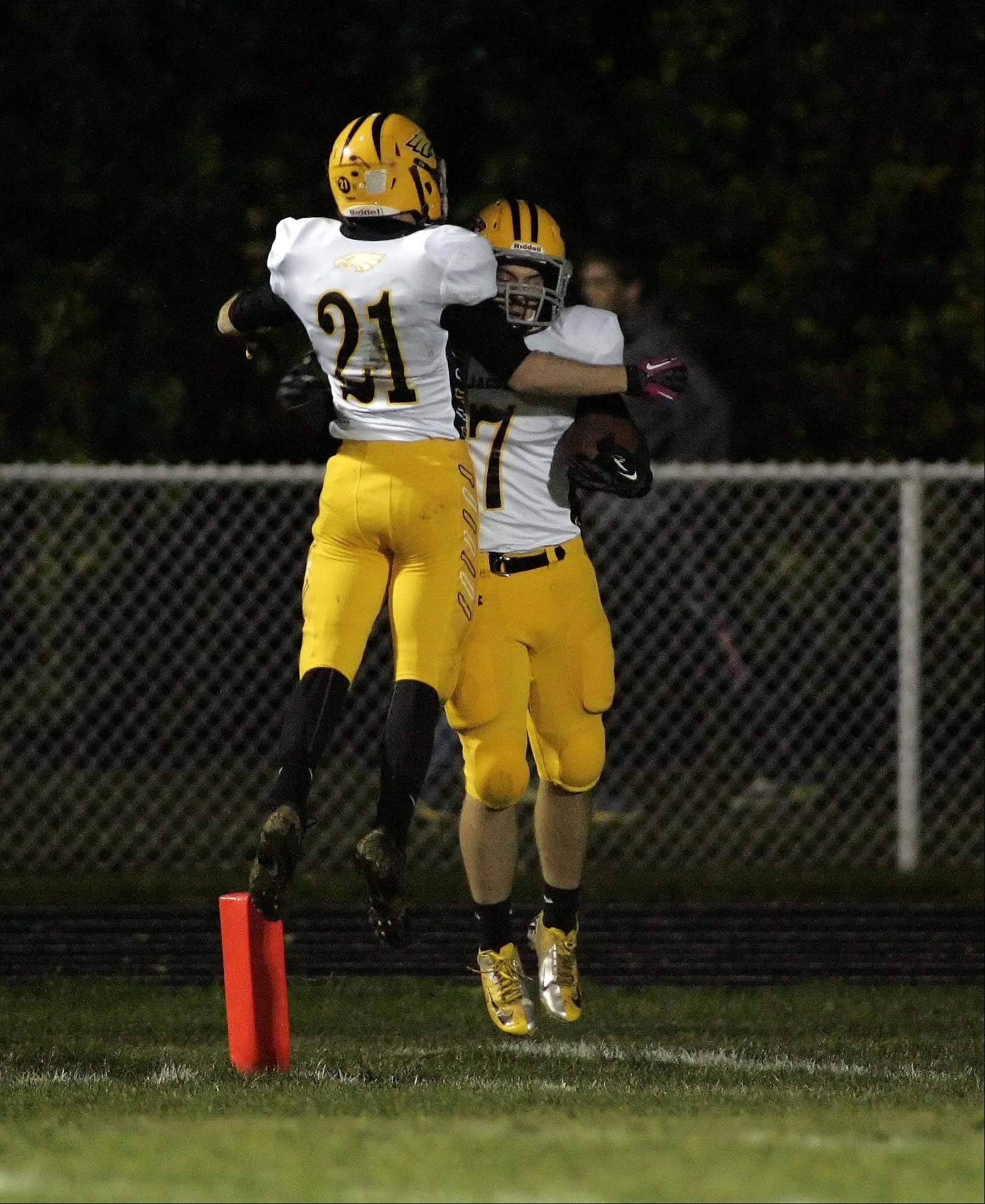 Jacobs' Hunter Williams greets Jake Gierlak in the end zone after a touchdown.