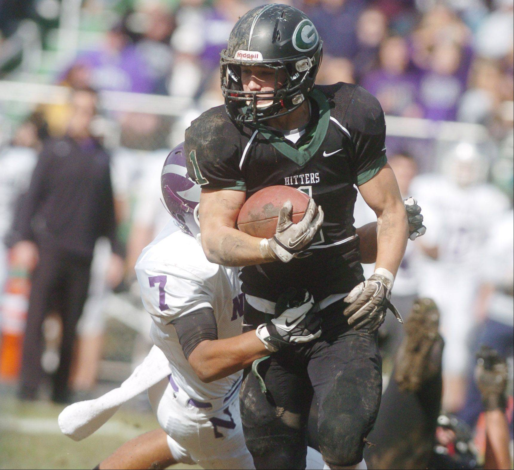 Joseph Zito of Glenbard West moves the ball during the Downers Grove North at Glenbard West football game Saturday.