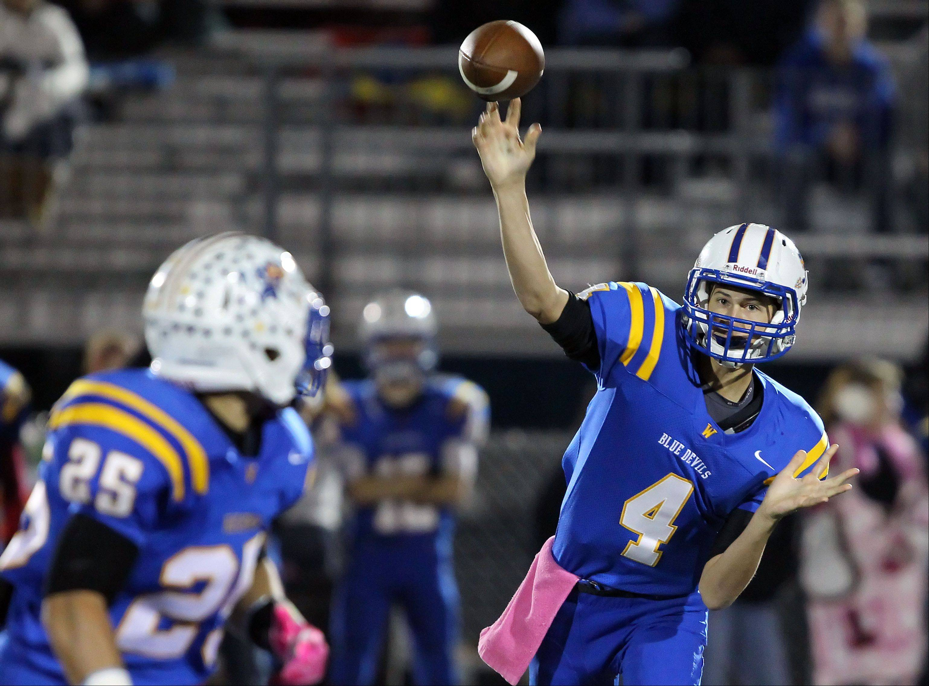 Warren quarterback Adam Reuss throws to Davonte Wilcox during the Blue Devils' loss to Lake Zurich on Friday. In Week 1 of the postseason, Warren will meet up with another familiar foe, Stevenson.