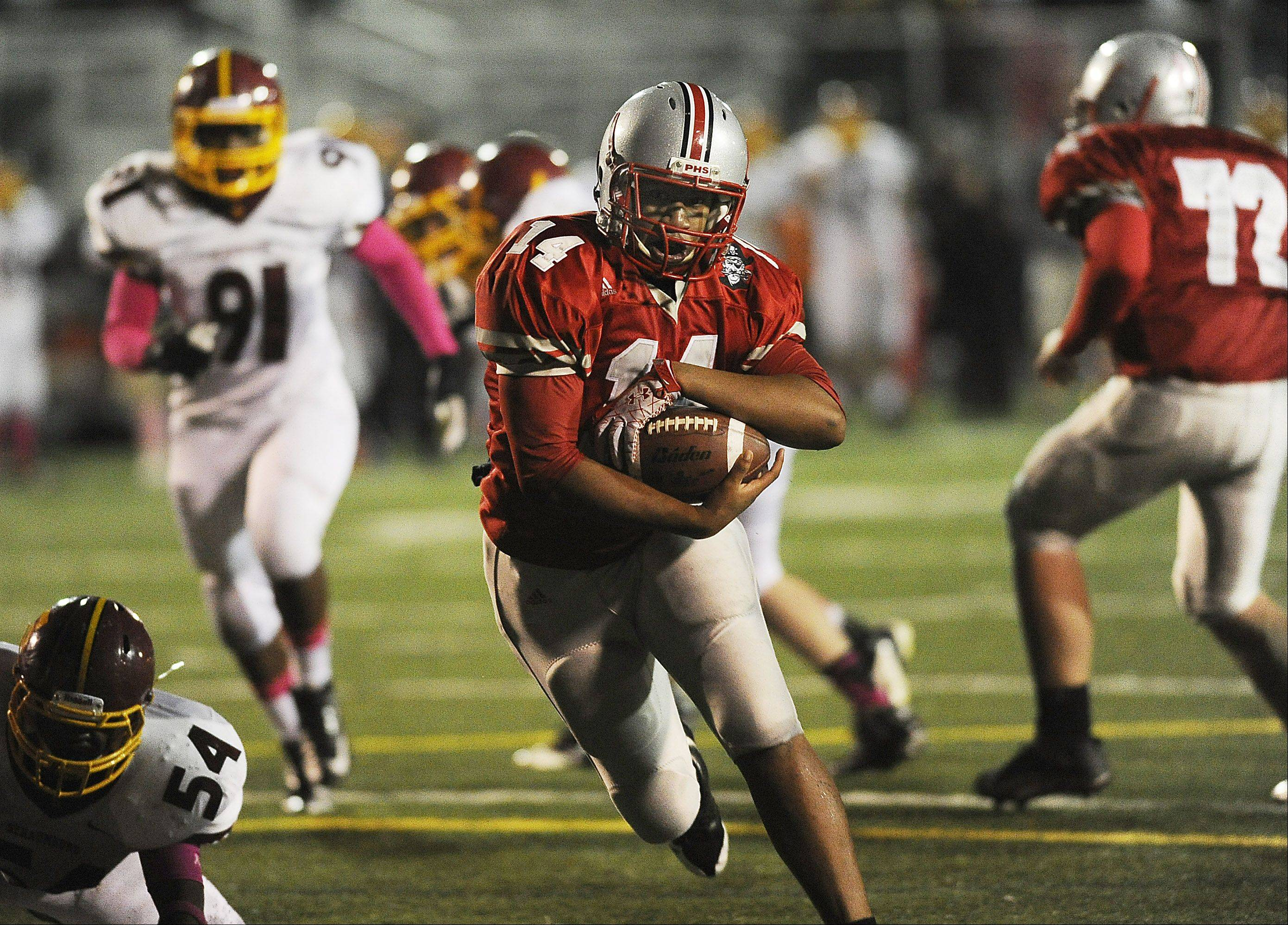 Palatine backup quarterback James Pittman sprints for a fourth-quarter touchdown Friday night in the Pirates' 51-18 victory over Schaumburg. If both teams win their first-round Class 8A playoff matchups, a second-round rematch awaits.