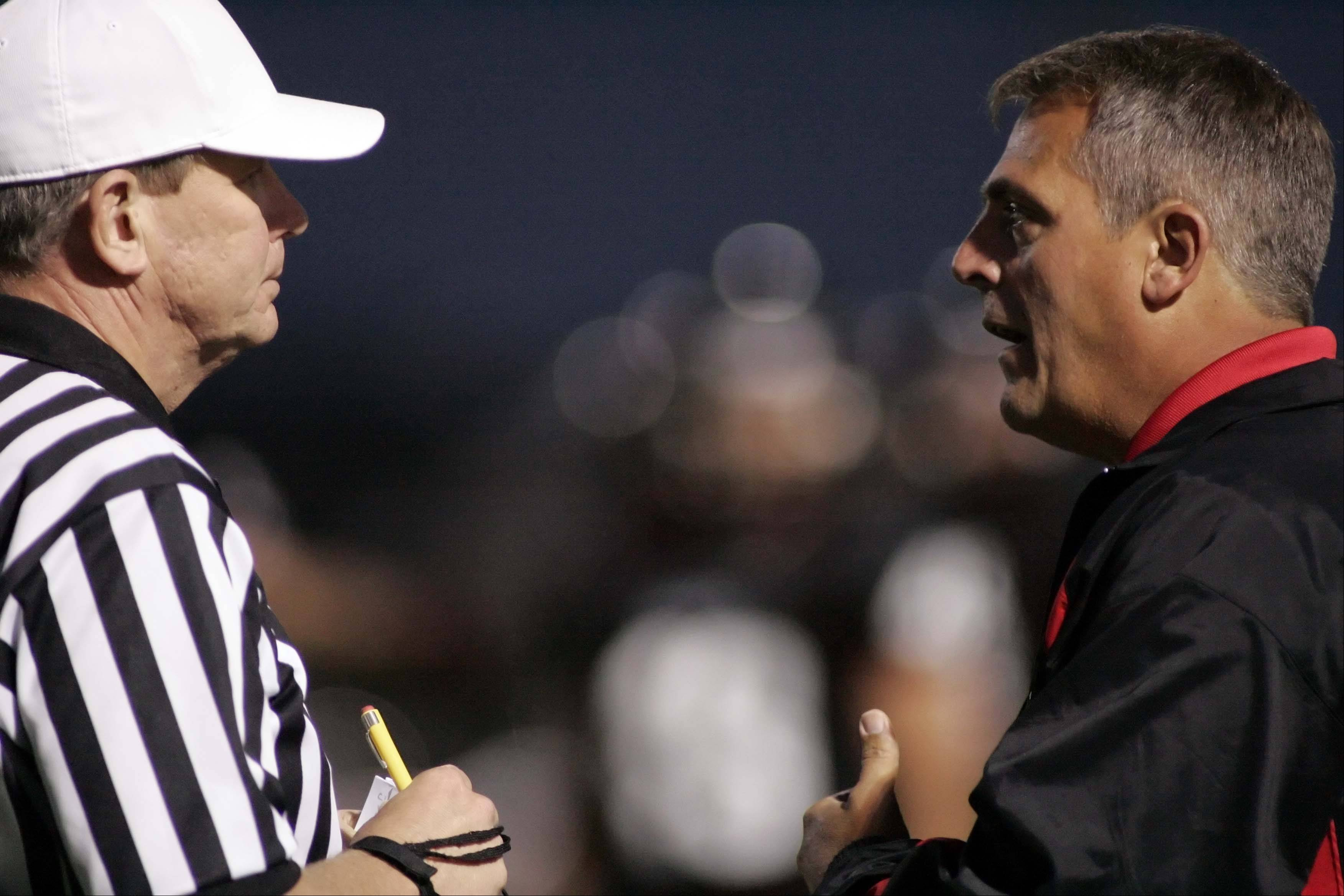 Brian Hill/bhill@dailyherald.com First-year Huntley coach John Hart knows what it takes to win in the postseason. Hart, who won two state titles in Indiana, will guide the Red Raiders Saturday at 7 p.m. when they face Fenwick at Morton High School in the first round of the Class 7A playoffs.