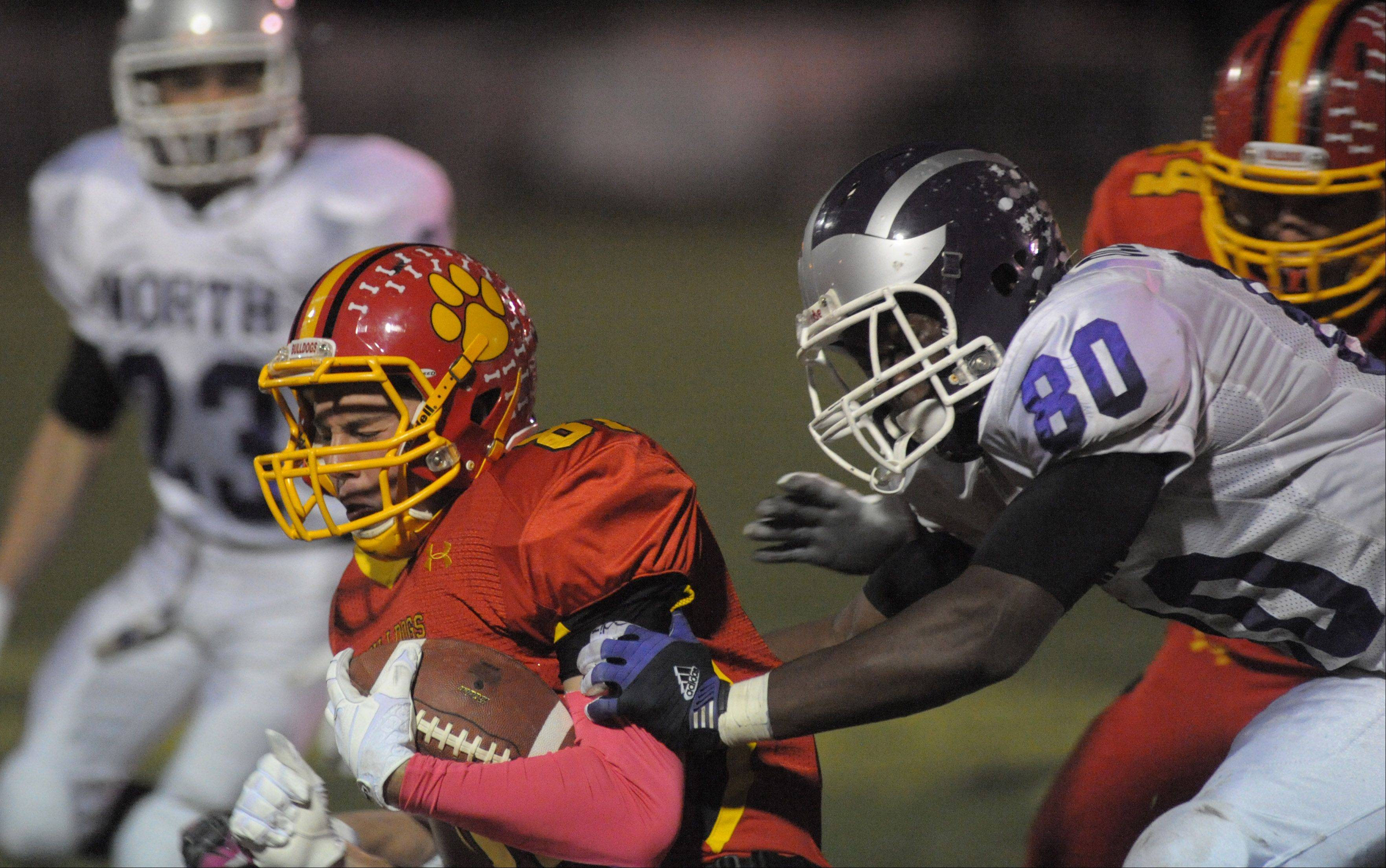 Downers Grove North's Richard Olekanma takes down Batavia's Jason Toth in the fourth quarter of playoff game on Friday, October 26.