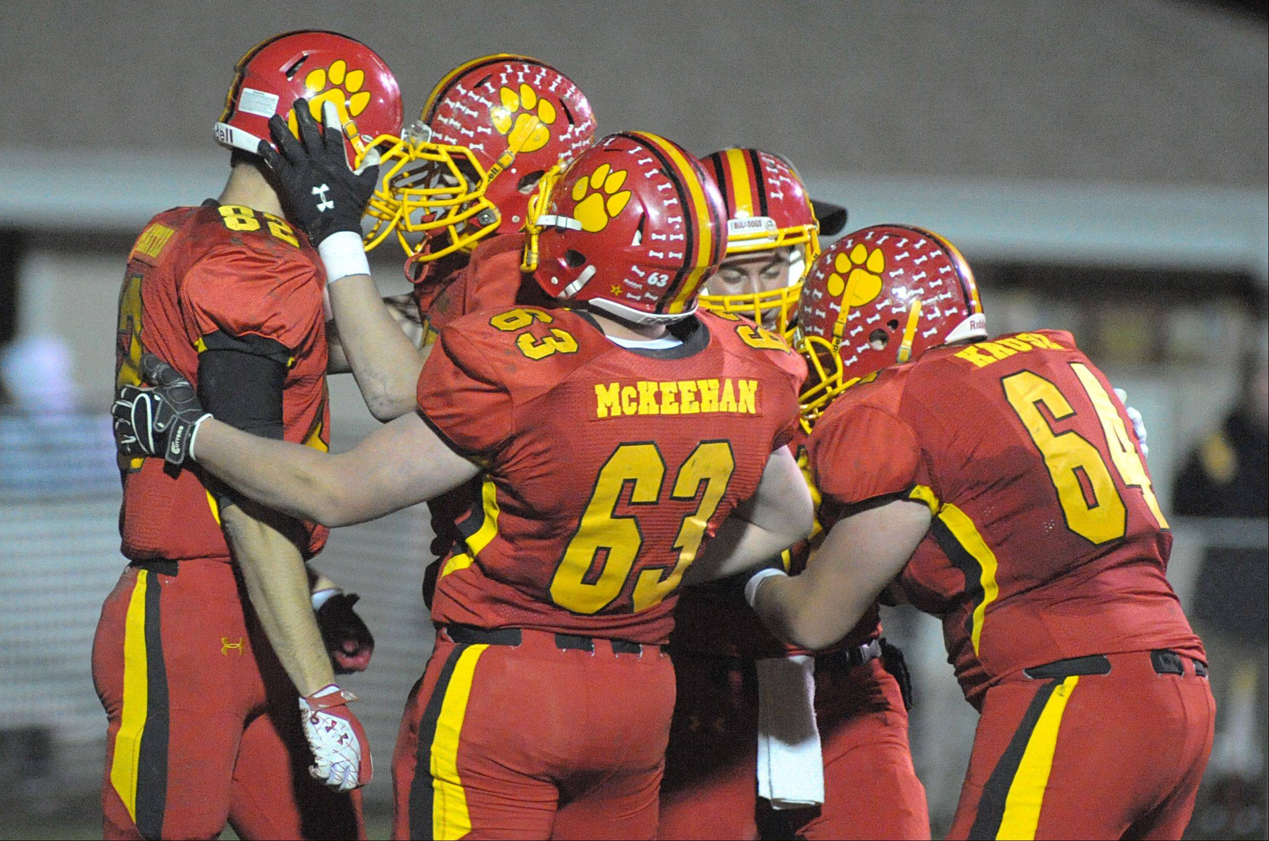 Batavia's Zachary Strittmatter is congratulated by Sebastian Vermaas and teammates after scoring a touchdown in the fourth quarter of playoff game on Friday, October 26.