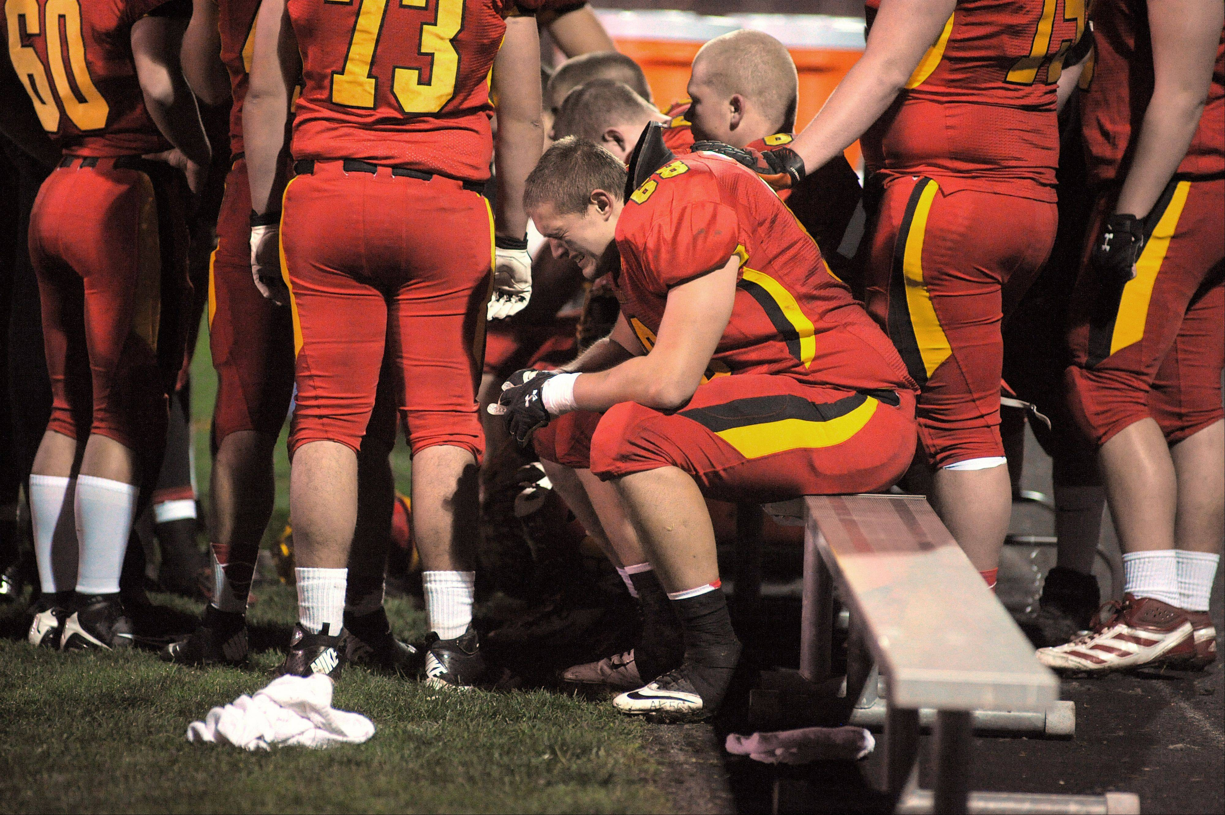 Batavia's Adam Hunger morns the Bulldogs playoff loss on Friday, October 26.