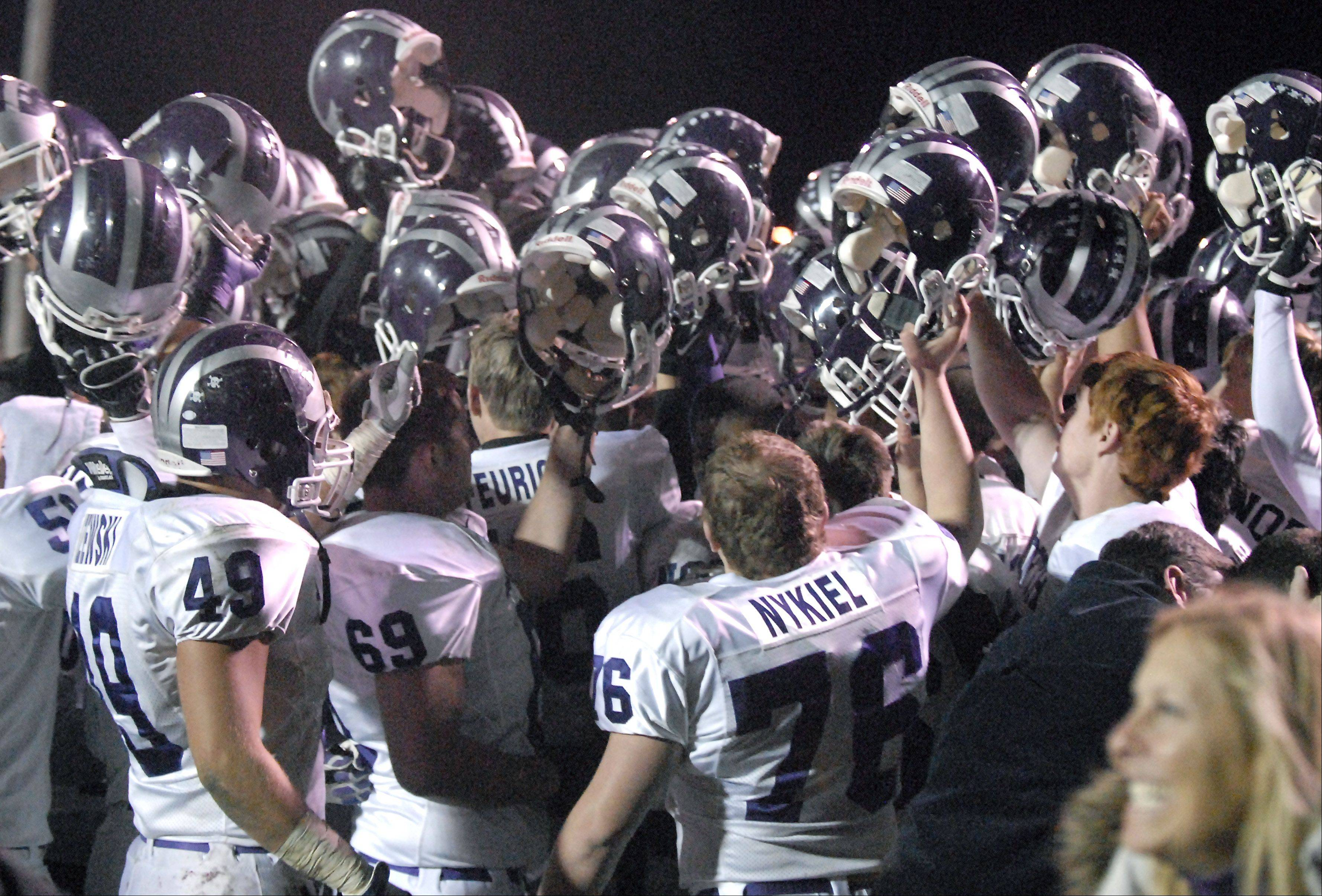 Downers Grove North's celebrates their playoff win over Batavia on Friday, October 26.