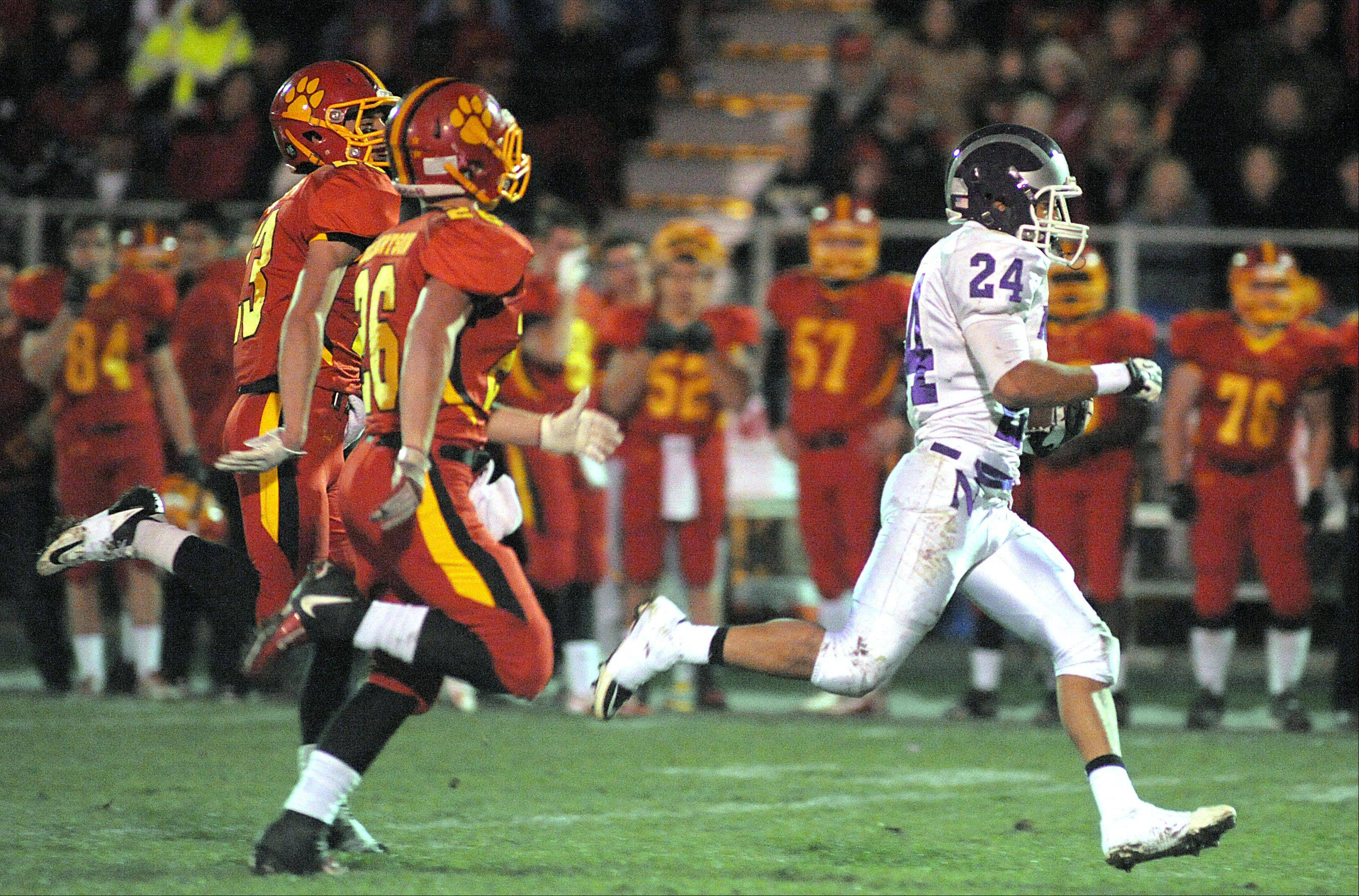 Downers Grove North's Brandon Salter runs for a touchdown in the fourth quarter of playoff game on Friday, October 26.