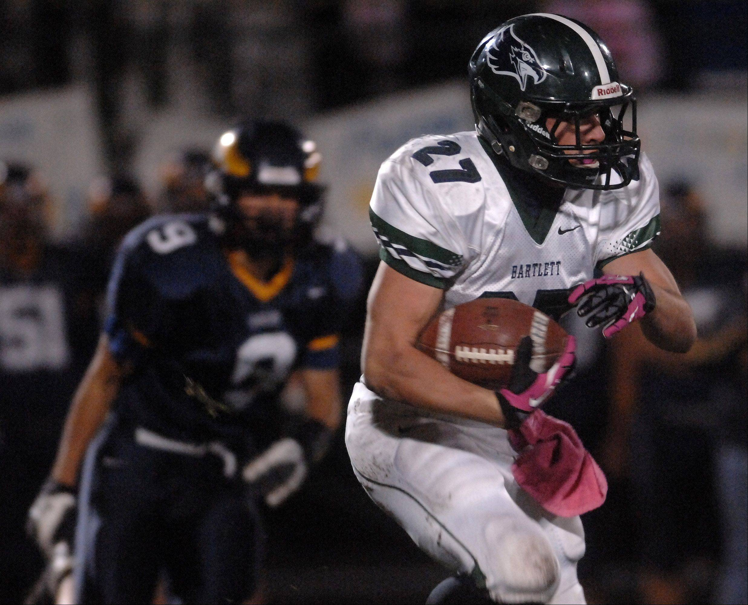 Bartlett's Aaron Everson (27) picks up a chunk of yards against Leyden in Northlake Friday.