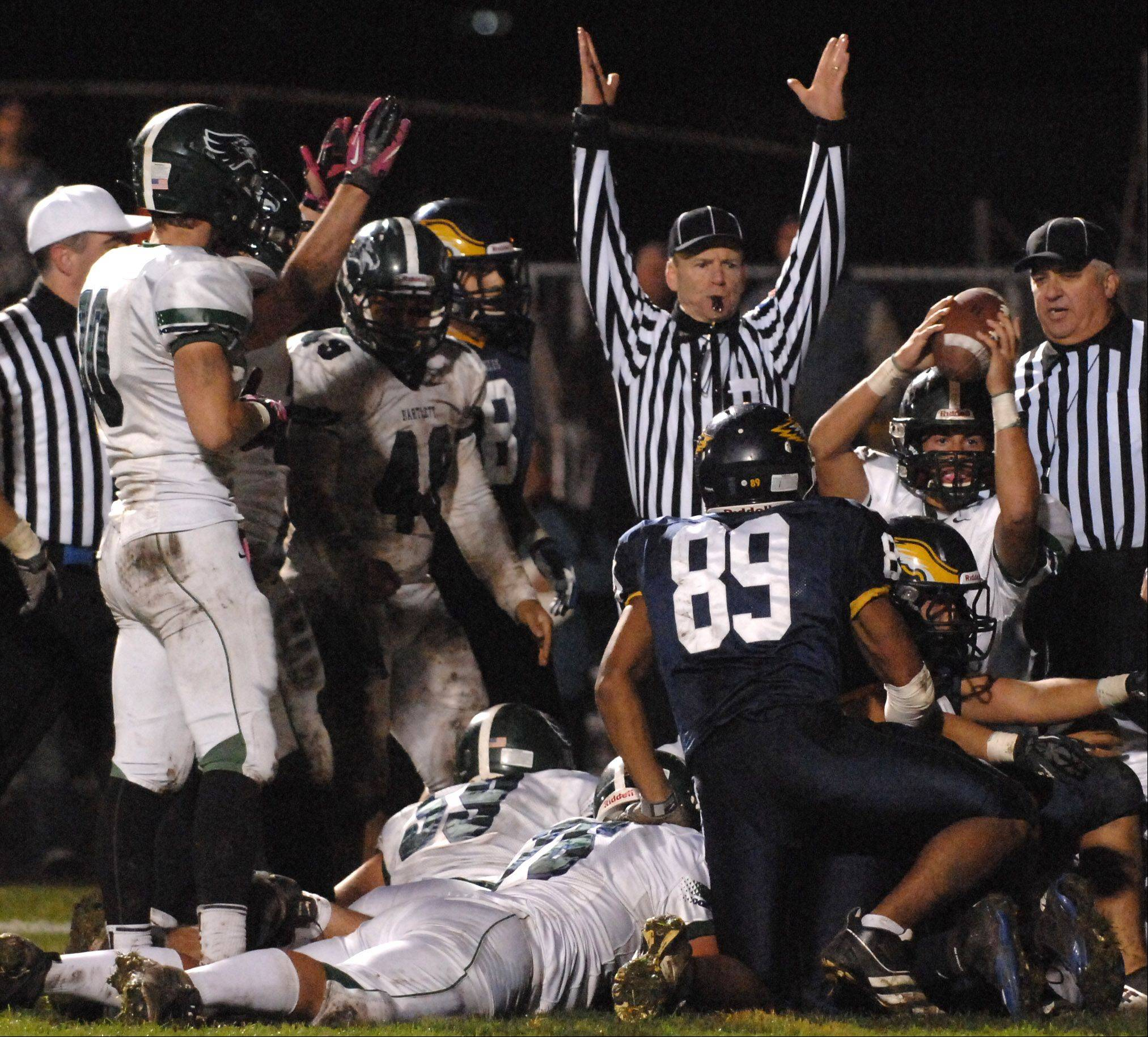 Bartlett's Kyle Garcia (11) holds up the ball as the referee signals touchdown to put the Hawks up 14-0 over Leyden in Northlake Friday.