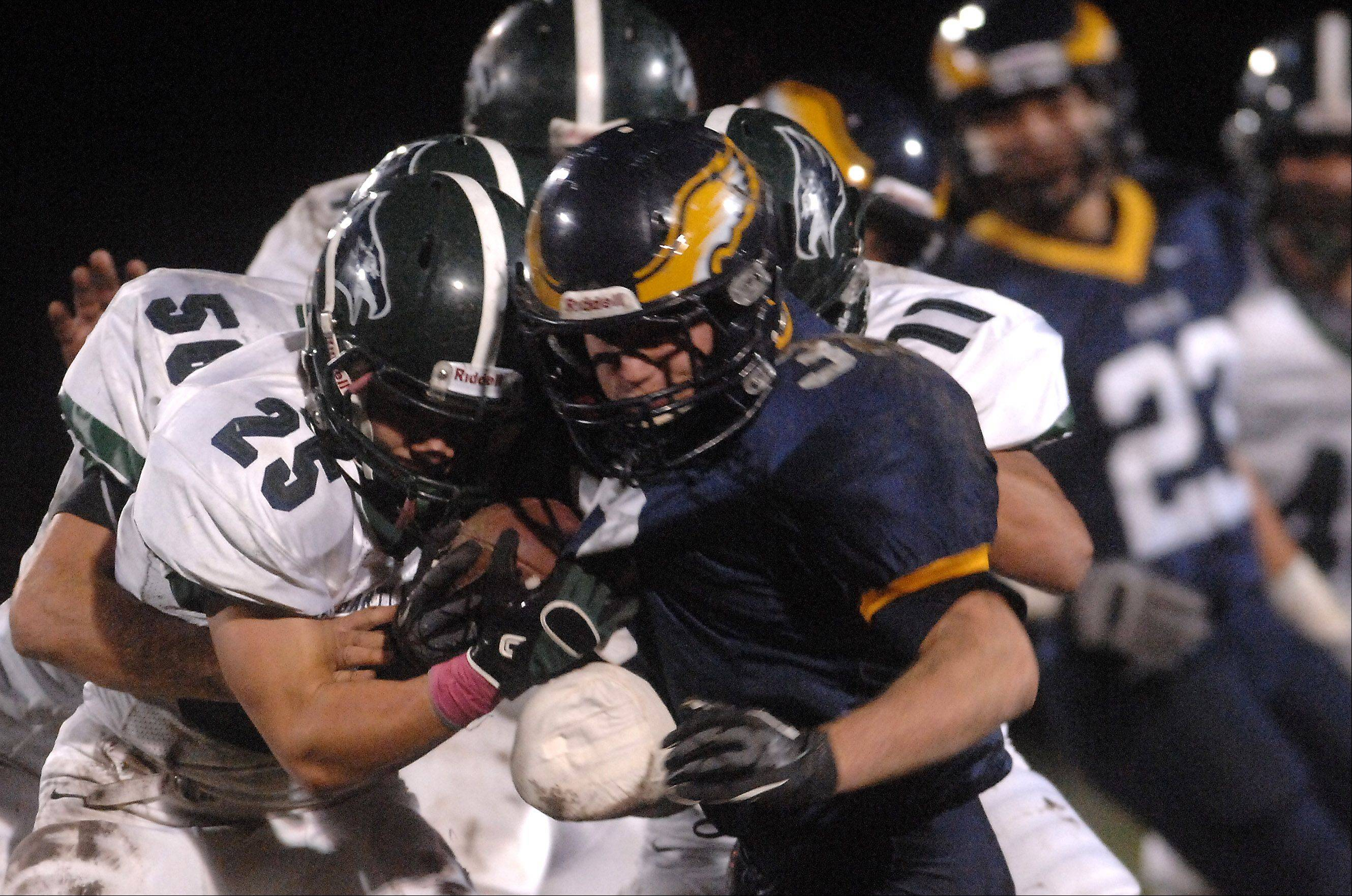 Bartlett's Nick Garcia (25) tries to rip the ball from Leyden's Mickey Gulo (30) in Northlake Friday.