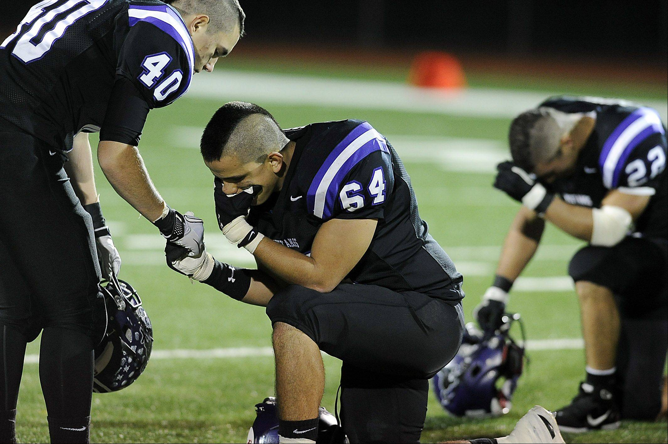 Rolling Meadows George Someris consoles with Raul-Alba Cortez after Rolling Meadows loss to Lake Forest in the Class 6A playoffs at Rolling Meadows High School on Friday.