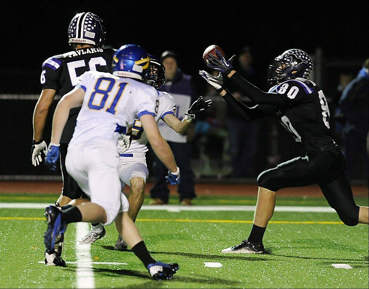 Rolling Meadow's Matt Dolan makes a interception on this tipped pass play from Lake Forest in the Class 6A playoff football game at Rolling Meadows High School on Friday.