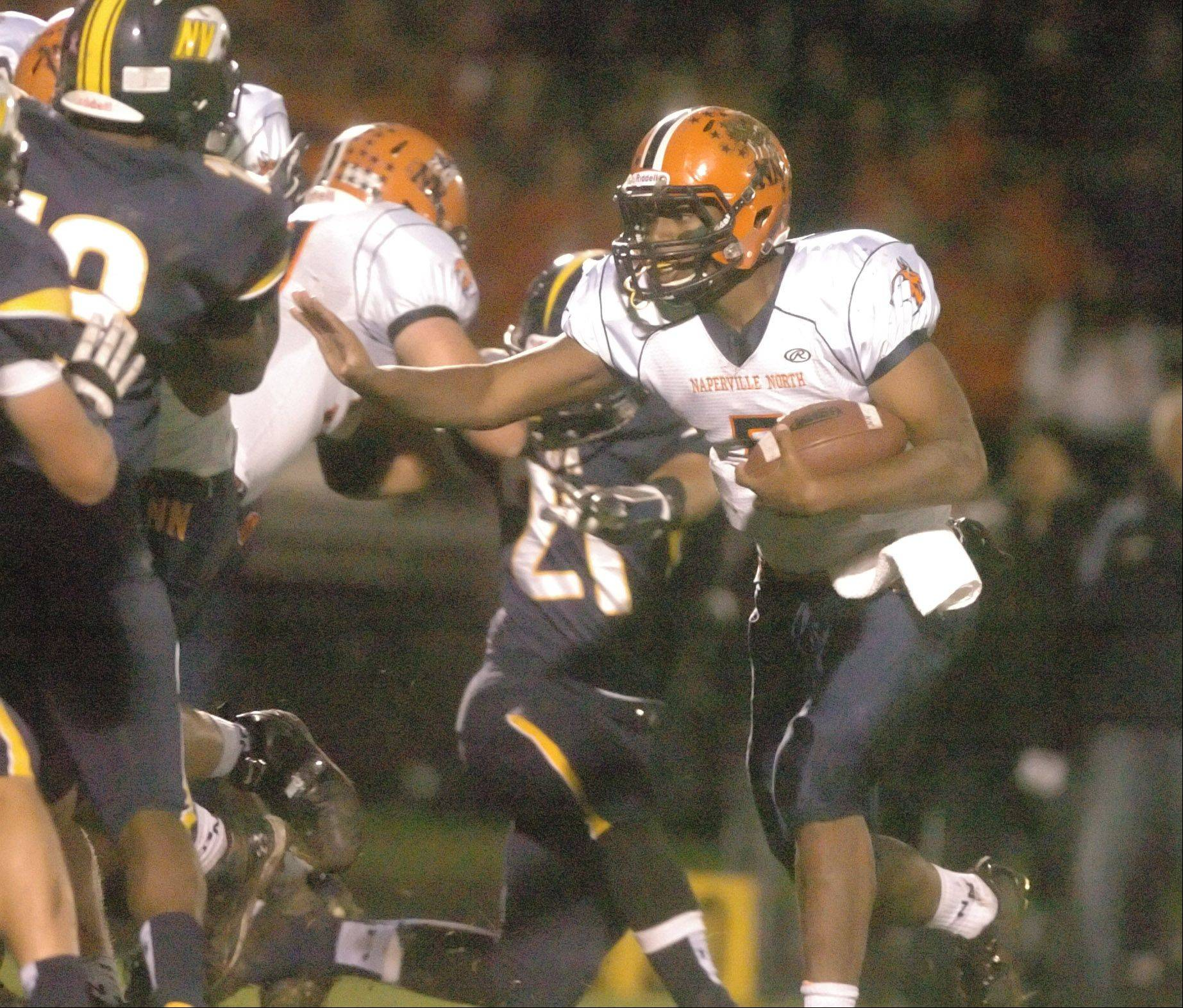 Johnny Brown of Naperville North looks for a hole during the Naperville North at Neuqua Valley football game Friday.