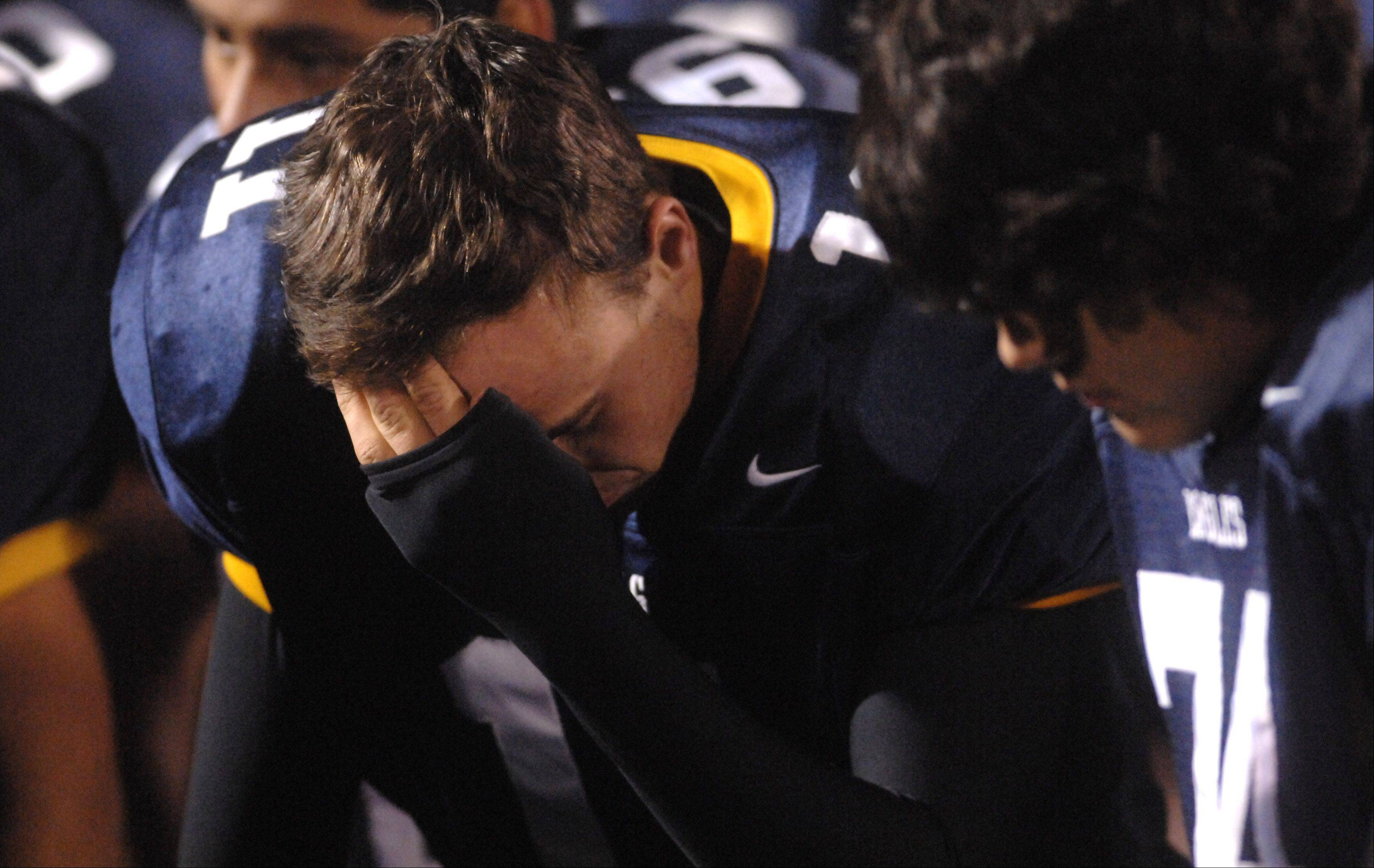 Leyden's k Mark Wach (11) and his teammates gather their thoughts after their loss to Bartlett in Northlake Friday.