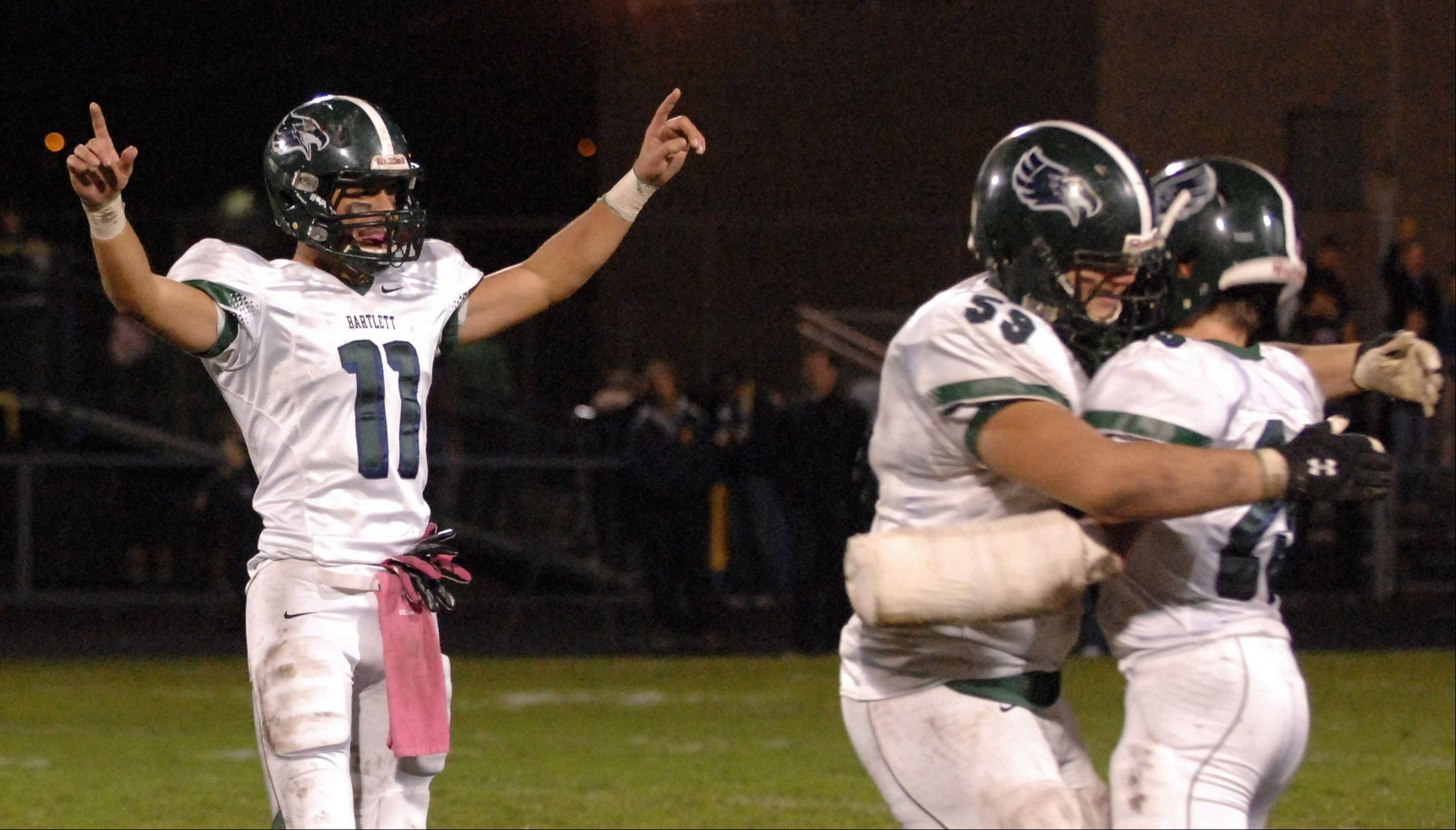 Bartlett's Kyle Garcia (11) and teammates celebrate after their first-round playoff win over Leyden in Northlake Friday.