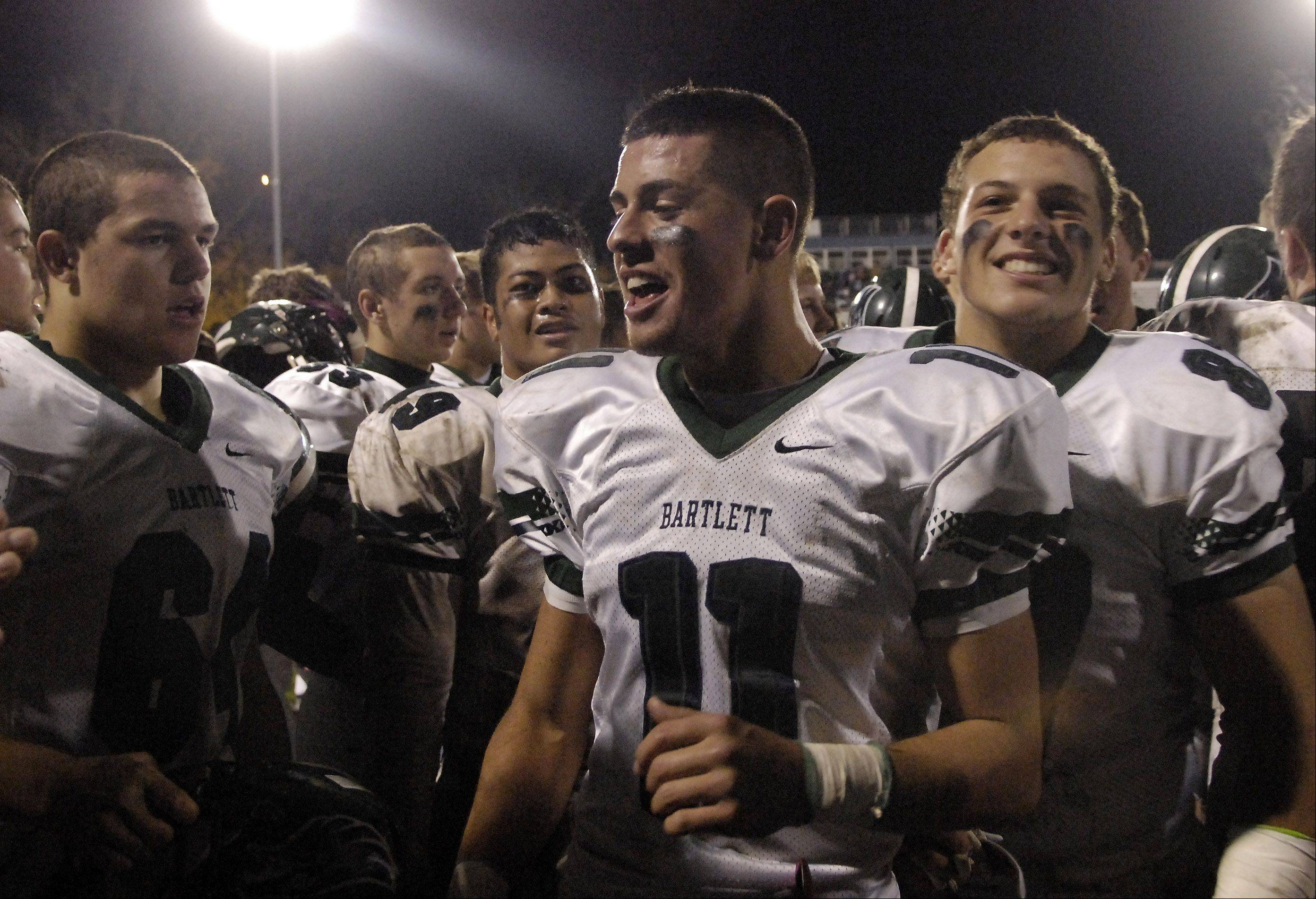 Bartlett's Kyle Garcia (11) and his teammates celebrate their win over Leyden in Northlake Friday.
