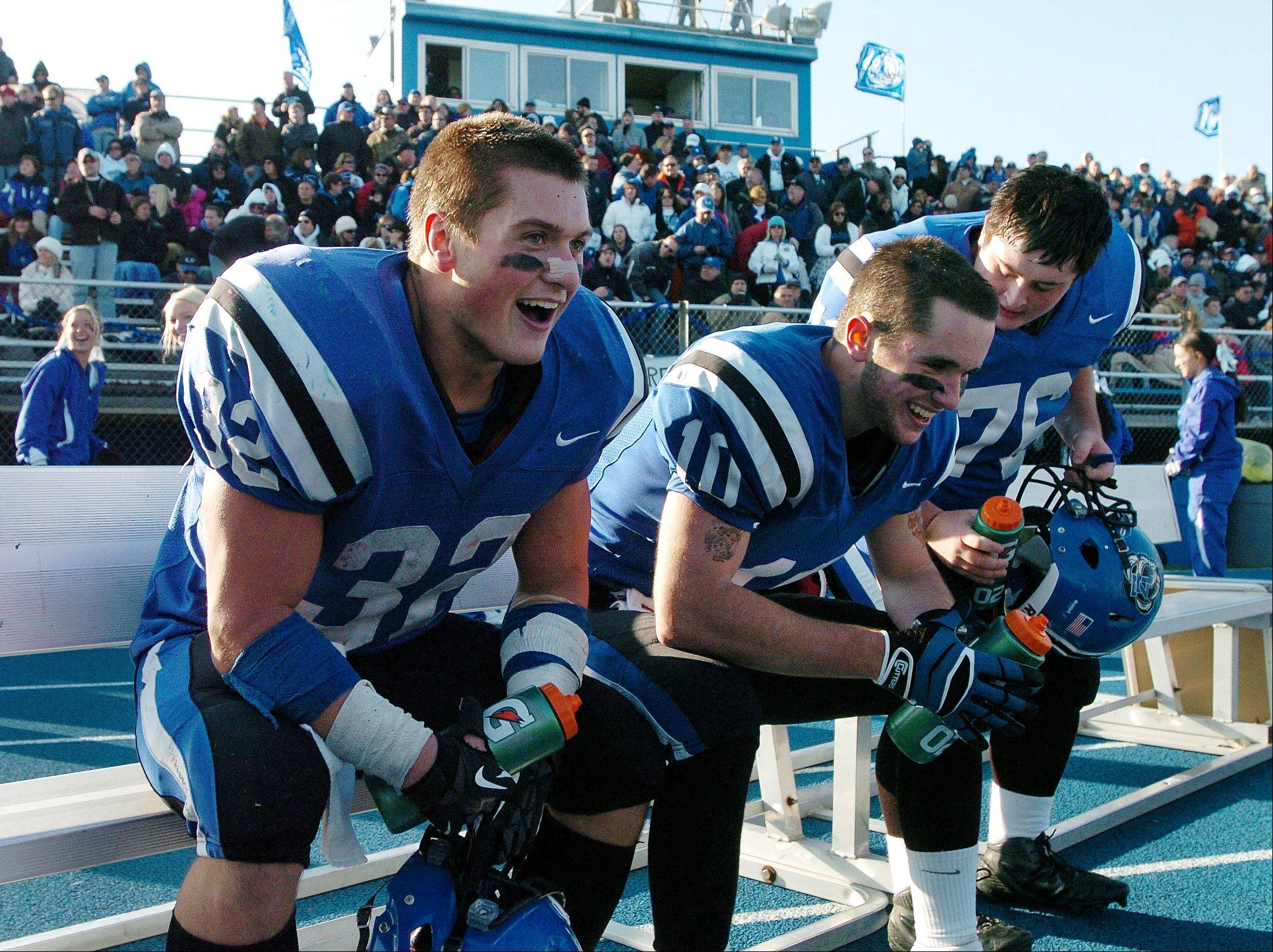 Running back Connor Schrader, left, celebrates on the bench with Jake Stauner, after scoring his fifth touchdown of the day during Lake Zurich's Class 7A playoff victory over visiting Crystal Lake South.