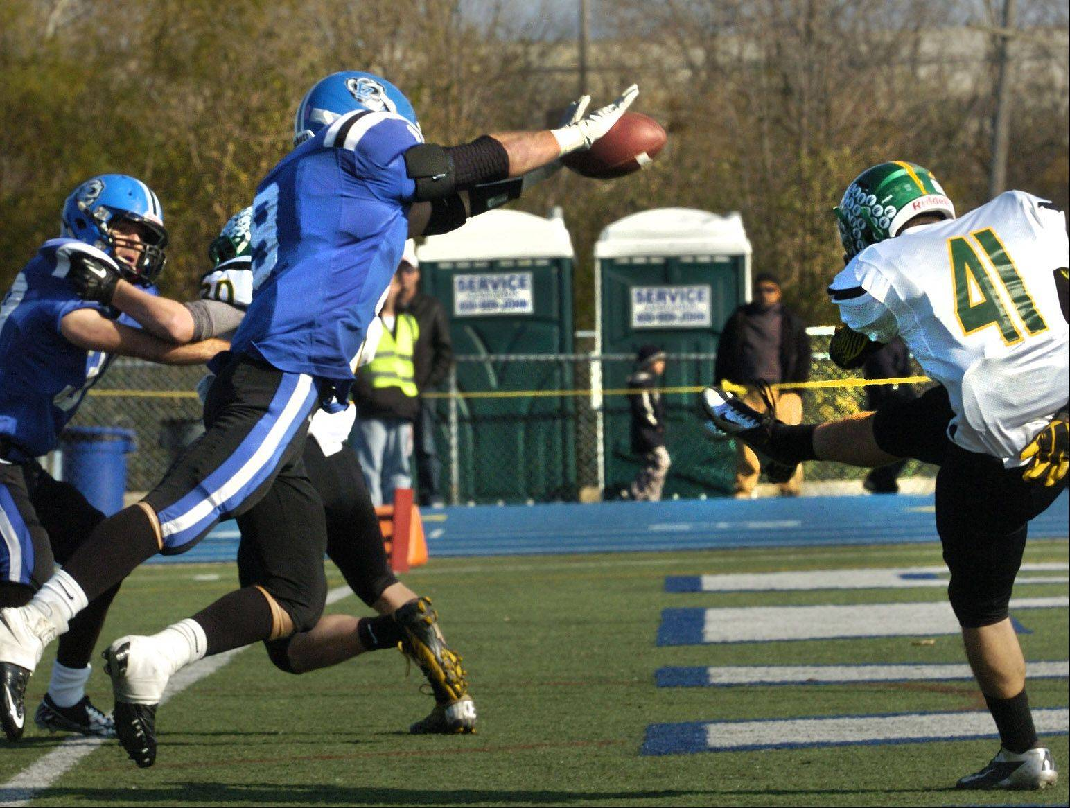 Colton Moskal of Lake Zurich blocks a Crystal Lake South punt for a safety in the first half of the Bears' Class 7A playoff victory Saturday.