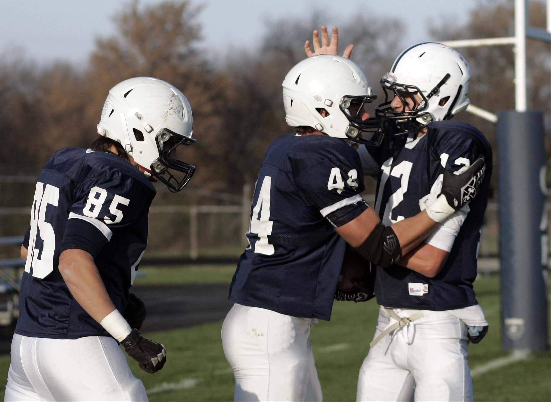 Cary-Grove's Kyle Norberg is greeted in the end zone by his team after his first touchdown of the game during Rockford Auburn at Cary-Grove in IHSA Class 6A playoff Football Saturday October 27, 2012.