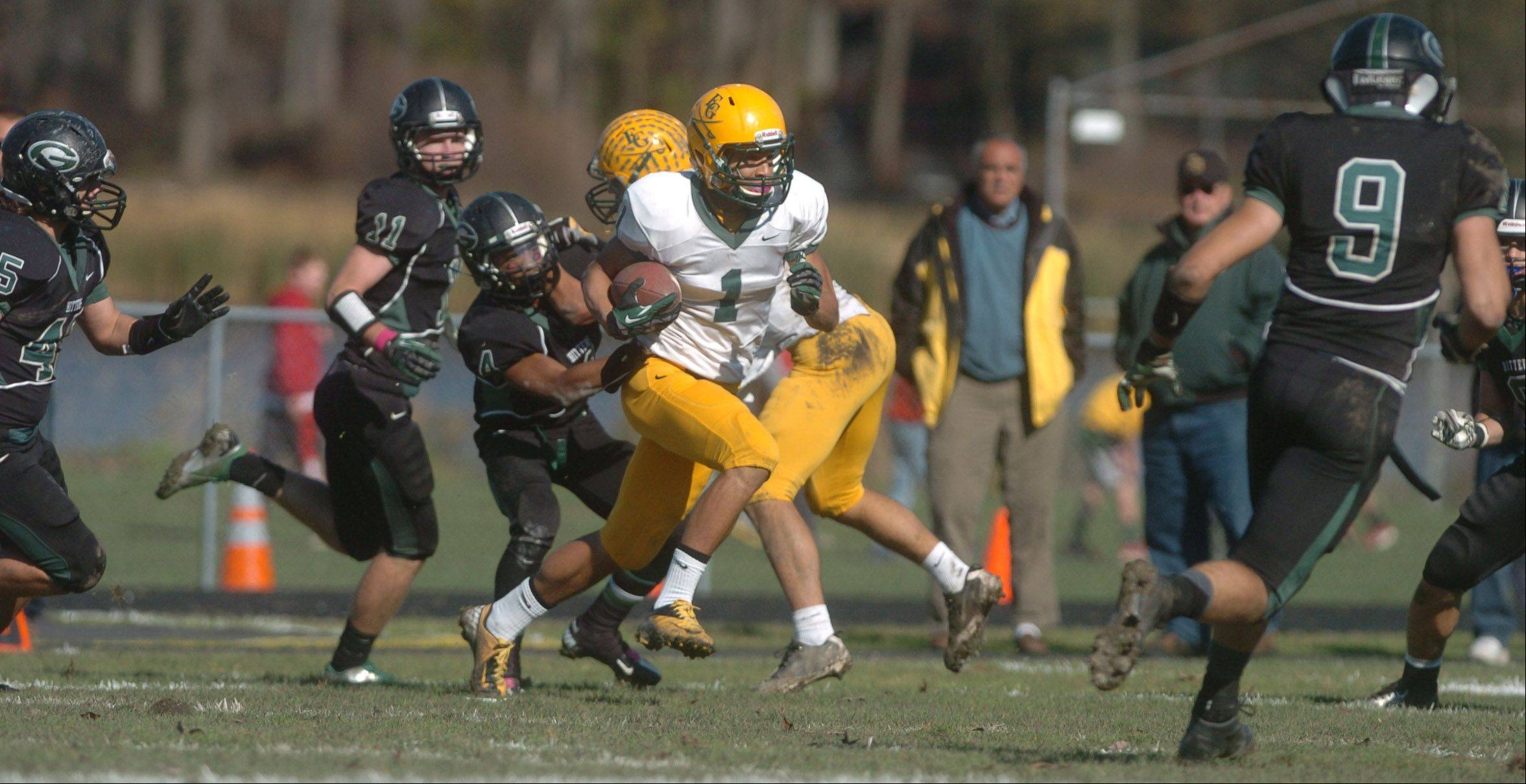 John Pass of Elk Grove moves the ball during the Elk Grove at Glenbard West football game Saturday.