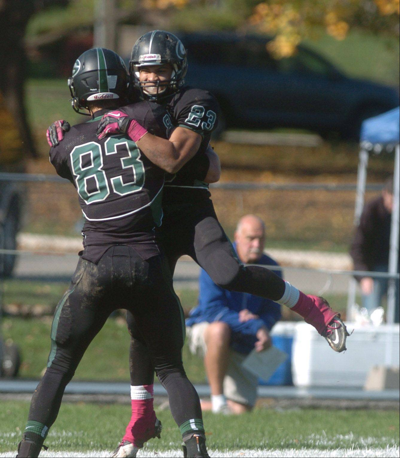 Nathan Marcus,left, and Scott Andrews of Glenbard West celebrate after a touchdown during the Elk Grove at Glenbard West football game Saturday.