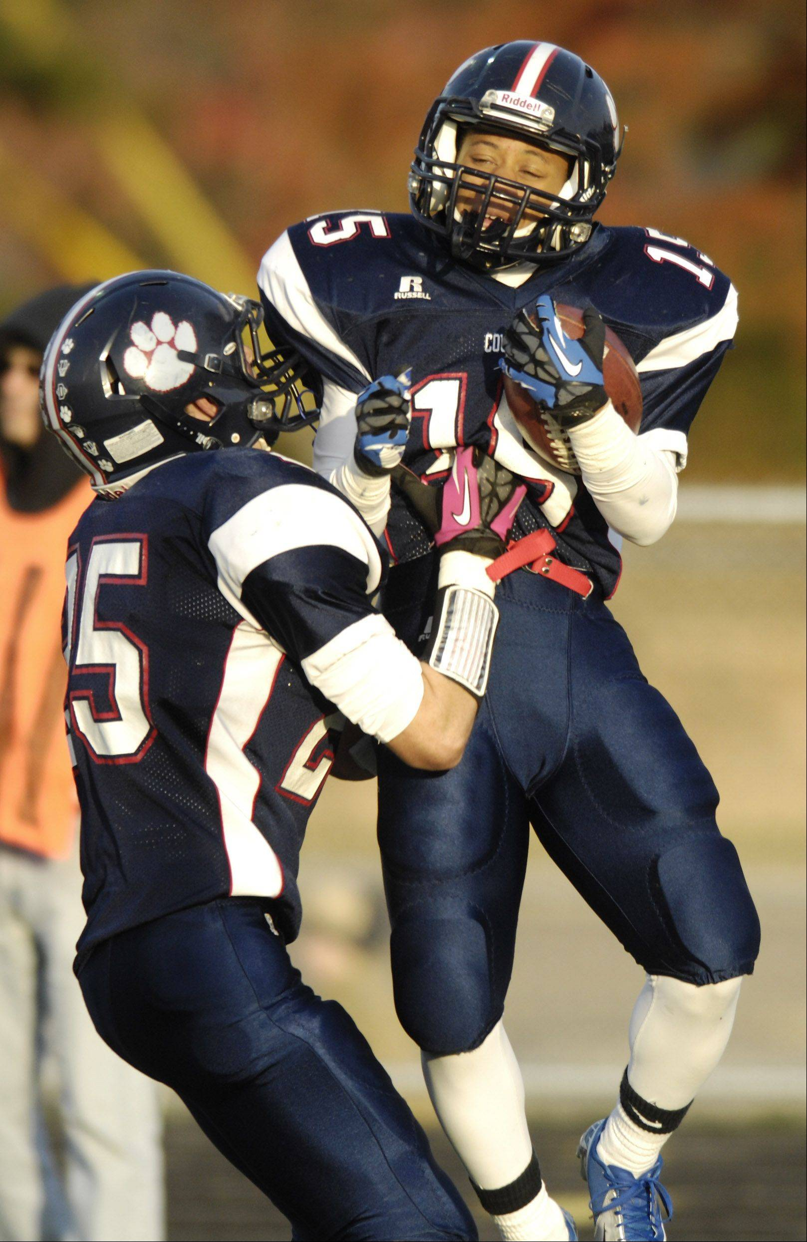 Conant's Bryson Brown, right, celebrates his fourth-quarter touchdown with teammate Mike Kos during Saturday's 14-0 win over New Trier.
