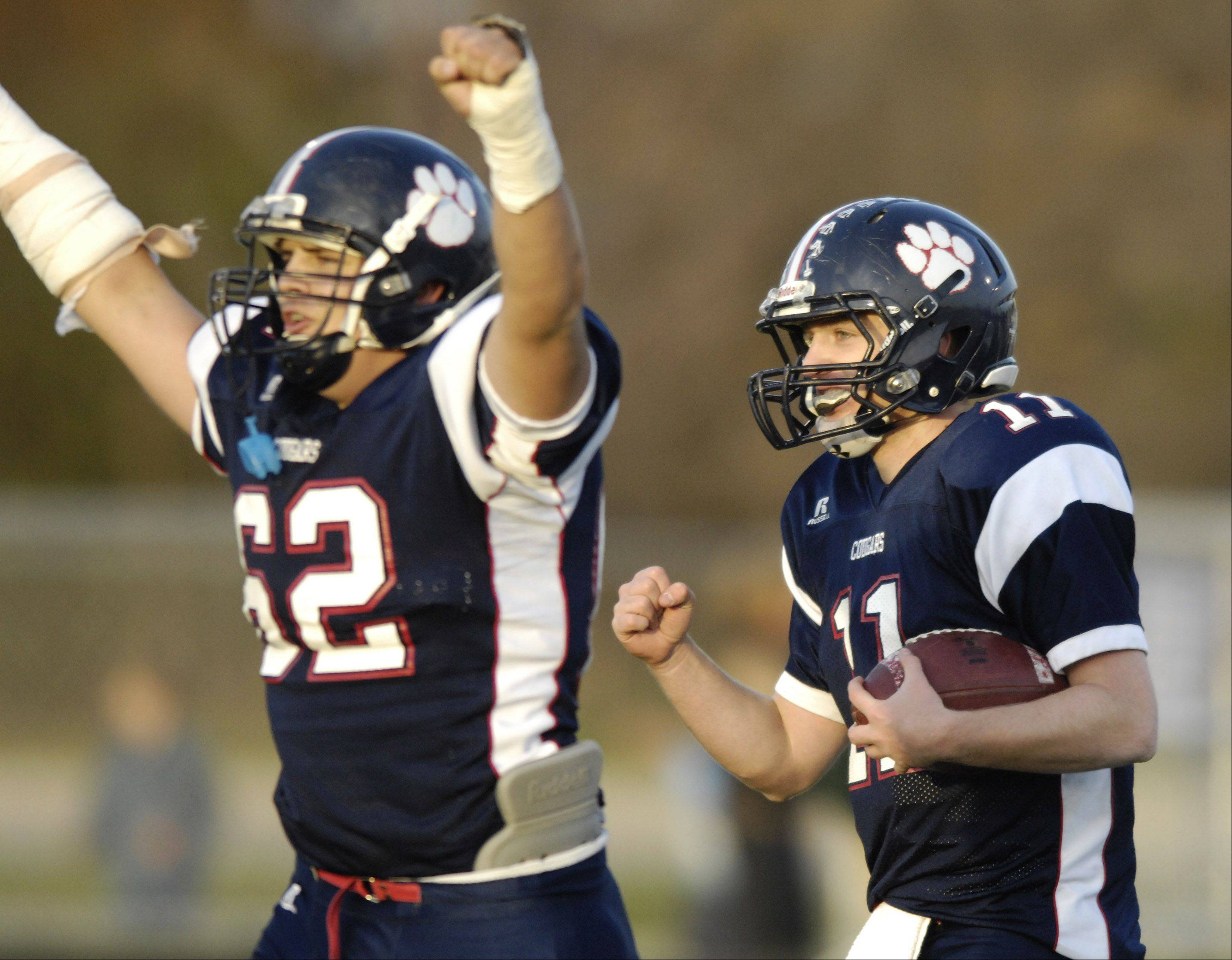 Conant's Alec Field, left, and Danny Modelski celebrate their team's 14-0 win over New Trier Saturday.