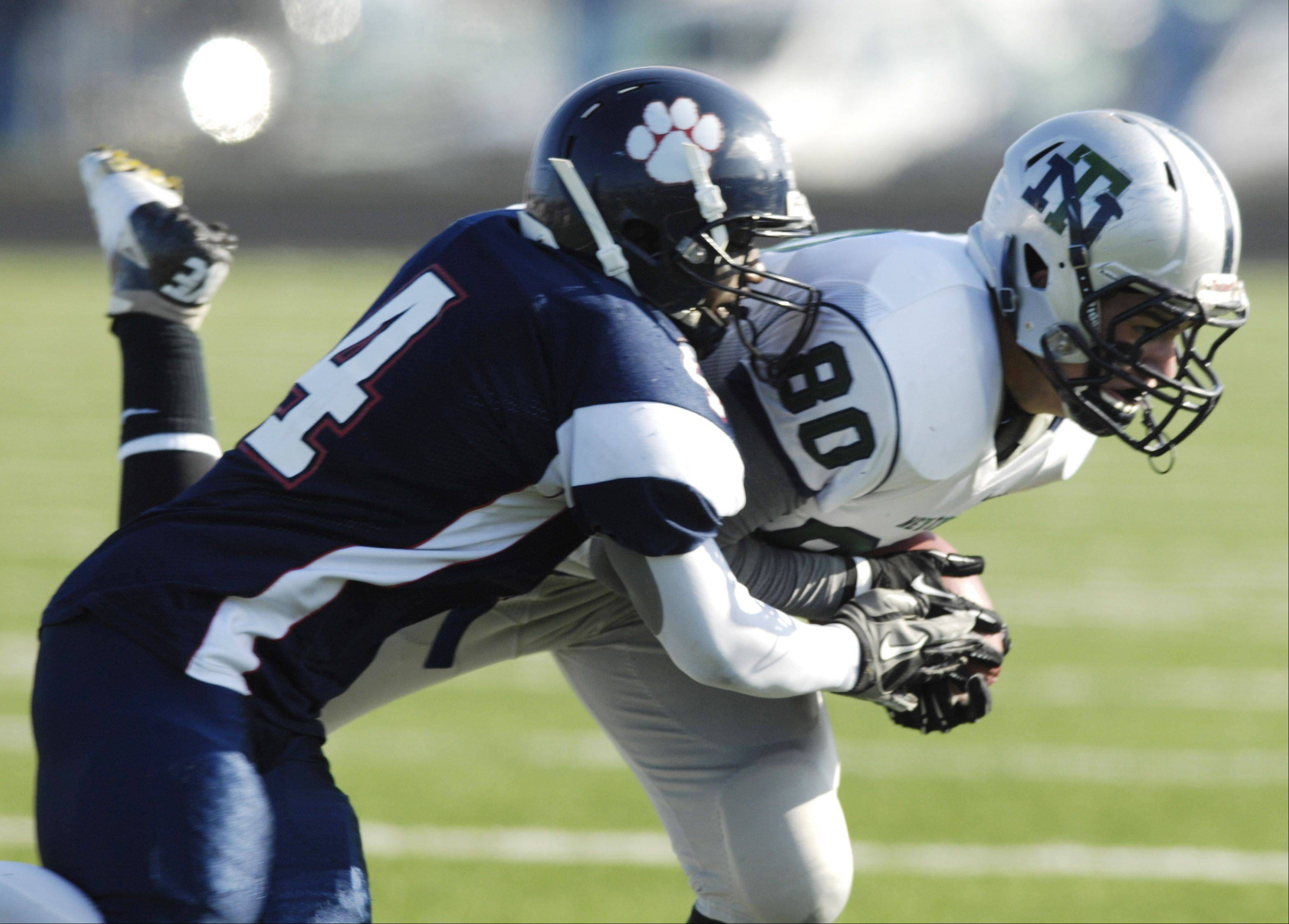 Conant's during Saturday's game.Fred Wortham tackles New Trier's Grant Klenovich during Saturday's game.
