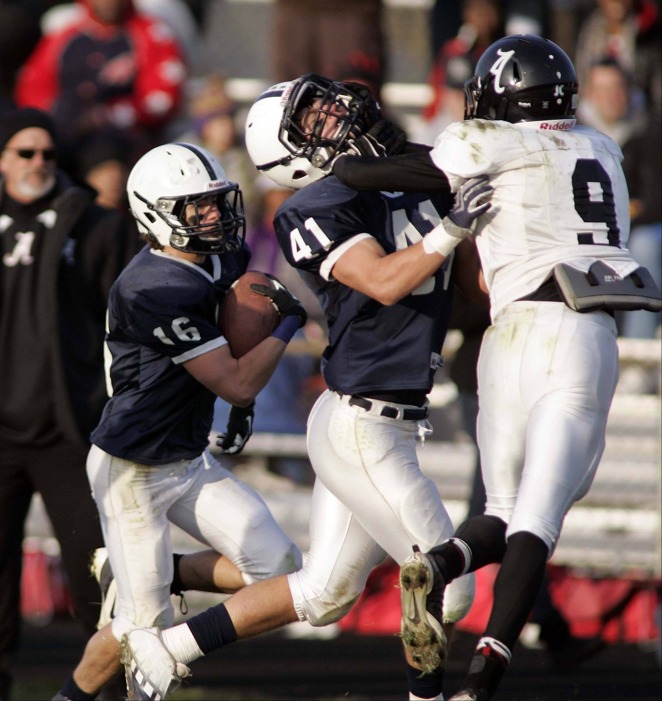 Cary-Grove's Zach Marszal (41) puts a block on Rockford Auburn's Corey Jefferson (9) to give Cary-Grove's Kaene Connington some more running room during Rockford Auburn at Cary-Grove in IHSA Class 6A playoff Football Saturday October 27, 2012.