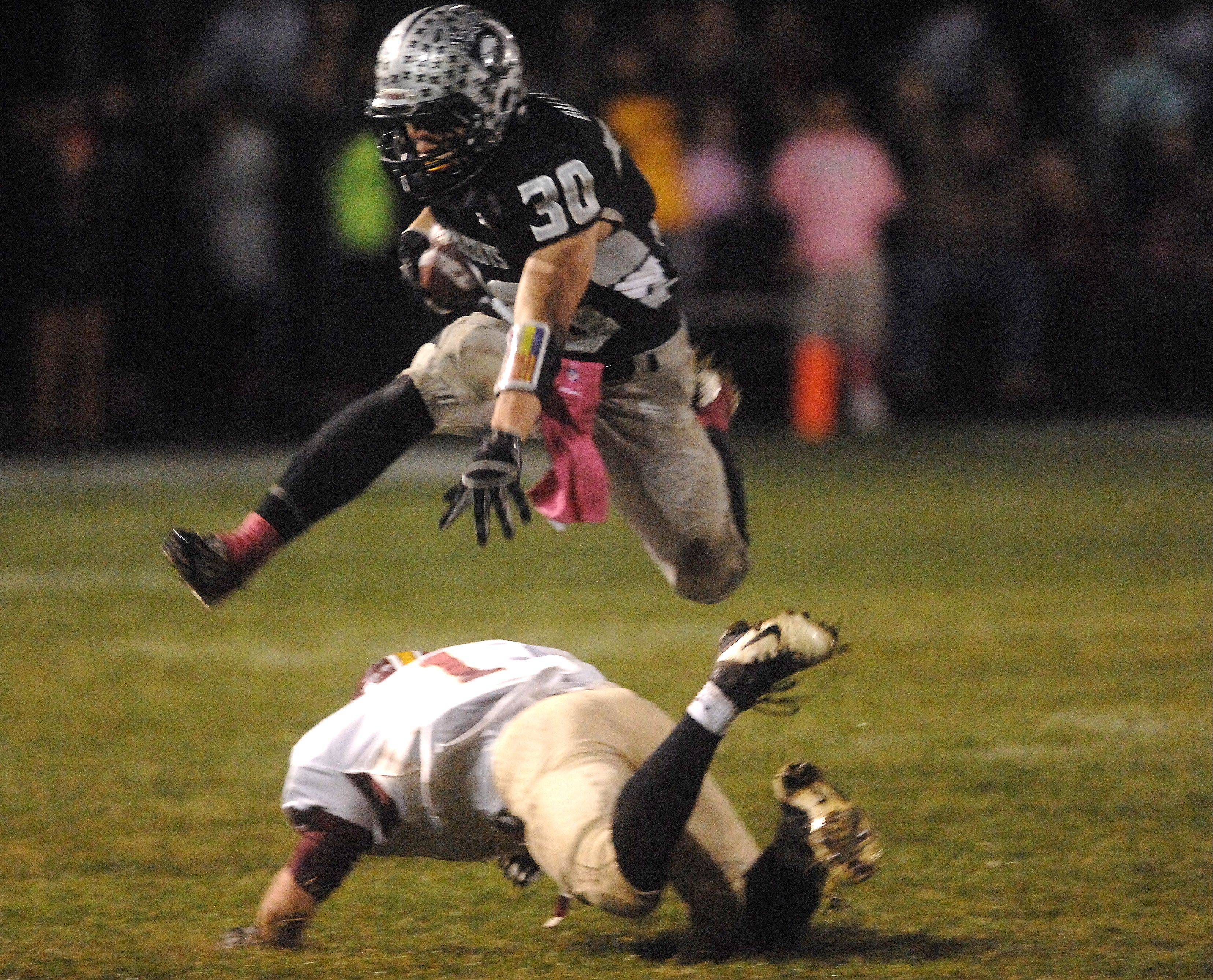 Kaneland's Jesse Balluff, pictured hurdling a would-be Morris tackler last month, will be a key part of the Knights' game plan at Lincoln-Way West Saturday.