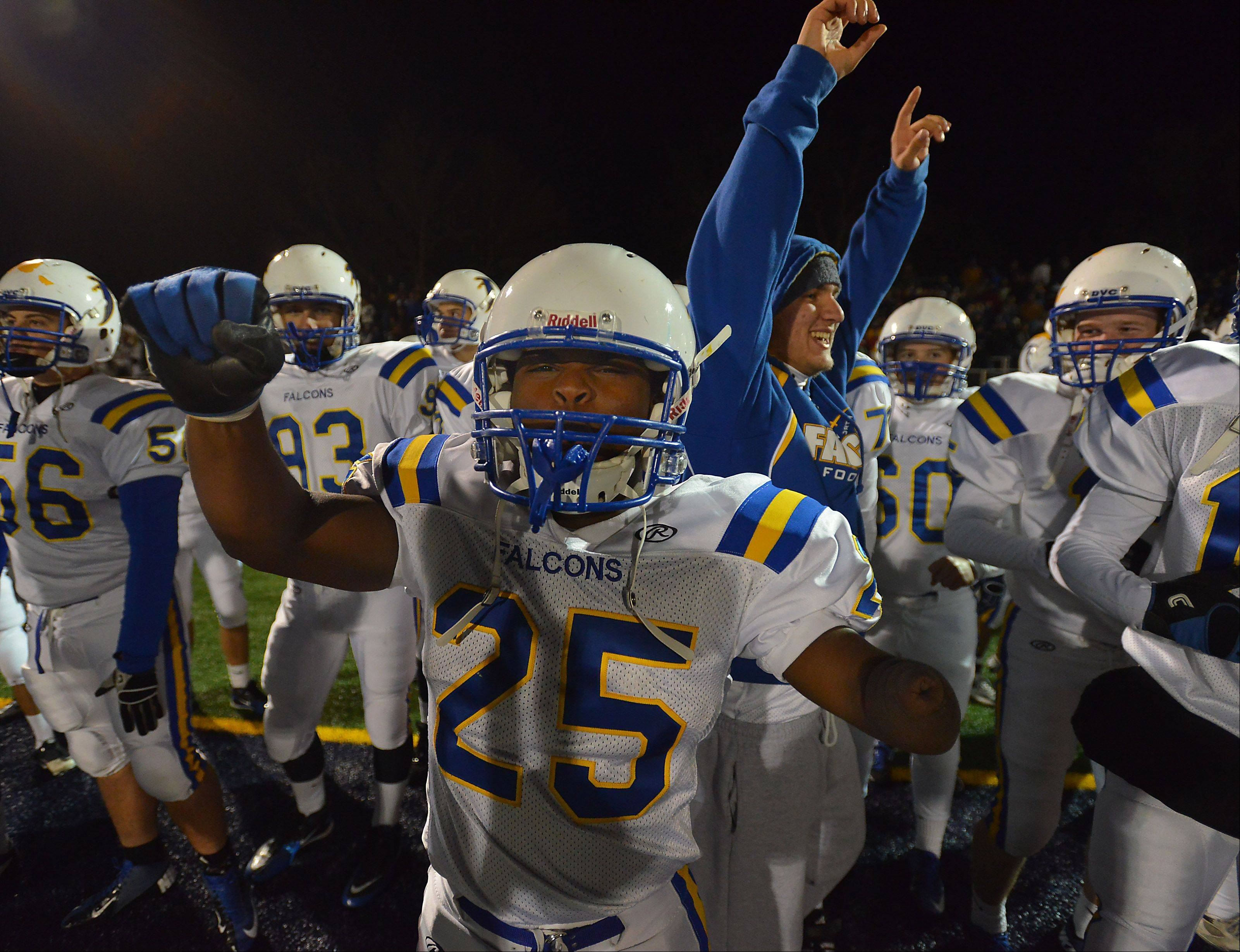 Wheaton North's Lataye Smith celebrates with his teammates in the fourth quarter with only seconds left to beat Prospect.